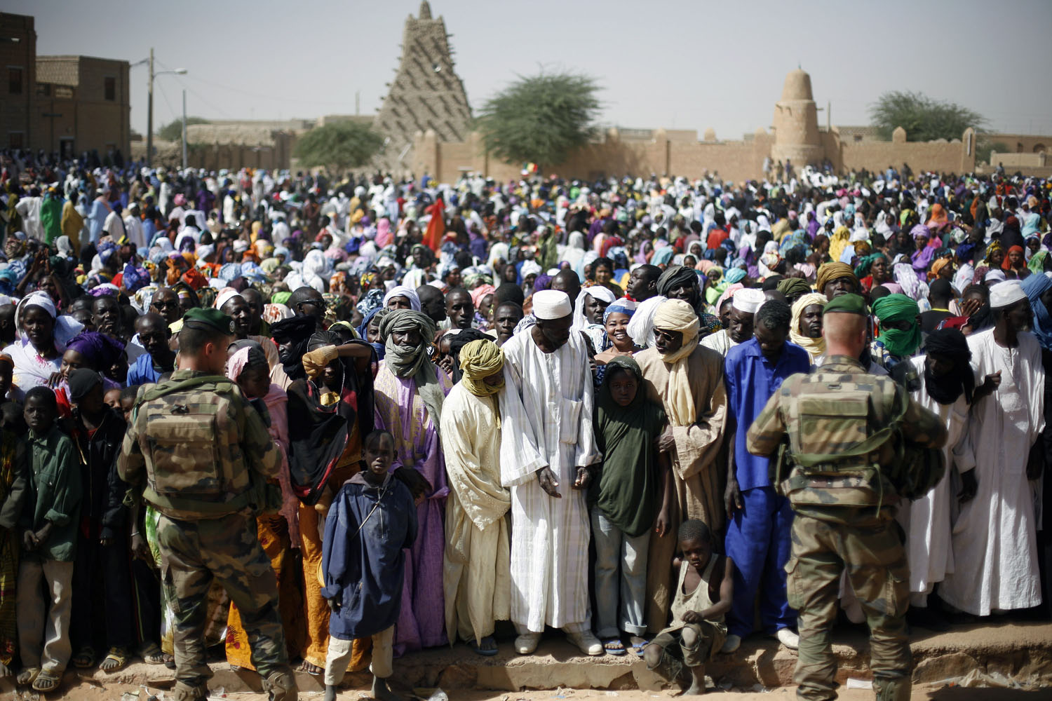 Well-wishers gather to greet French President Francois Hollande during his two-hour-long visit to Timbuktu, Feb. 2, 2013.