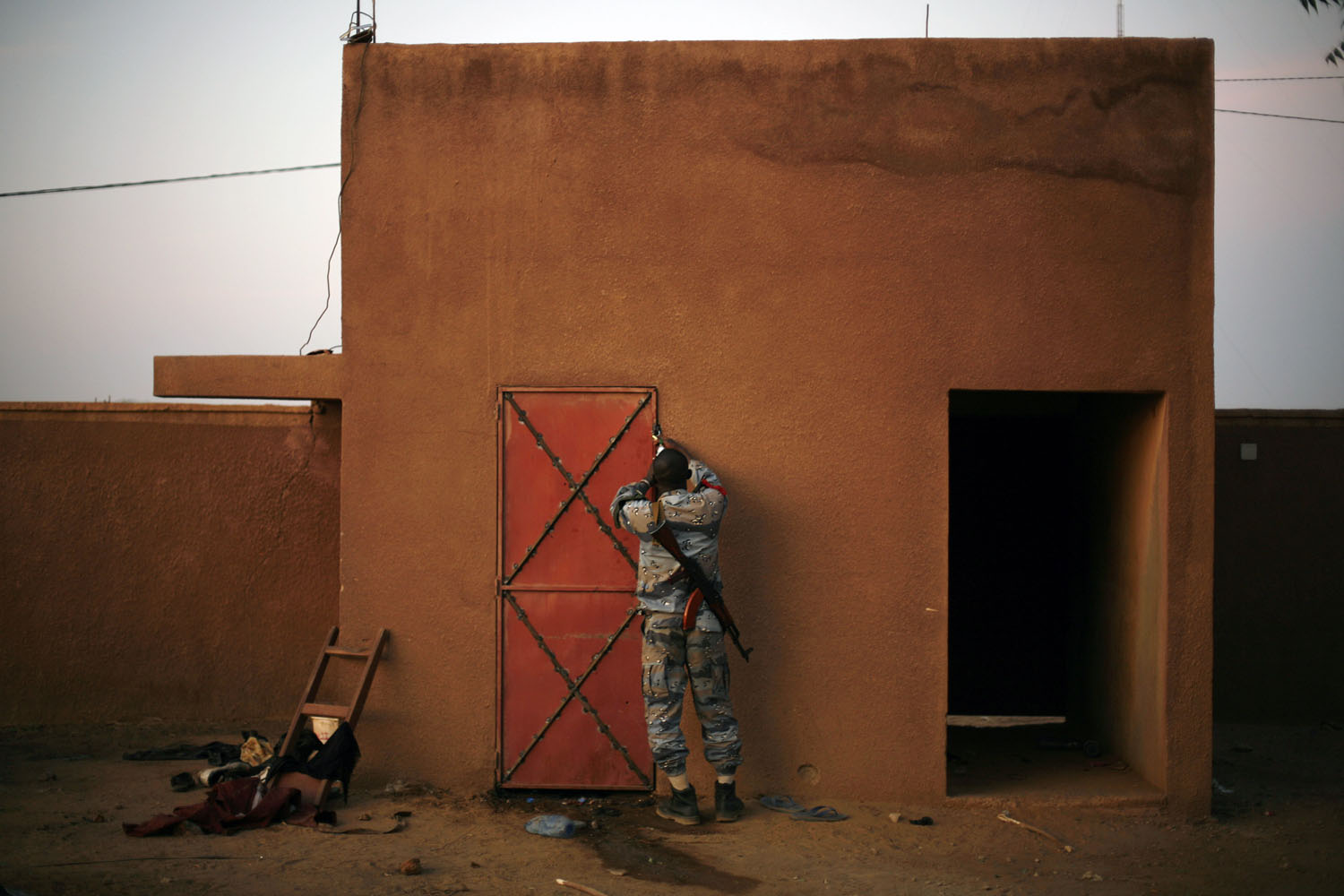 A Malian officer closes a cell where suspected  Islamist rebel group 'the Movement for Oneness and Jihad in West Africa,' MUJAO, fighters are held in Gao, Feb. 11 2013.