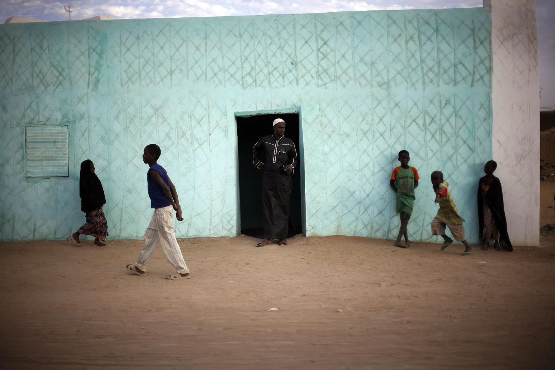 Malian children walk outside a Madrassa, or Quranic school, in  Gao, northern Mali, Feb. 13, 2013.