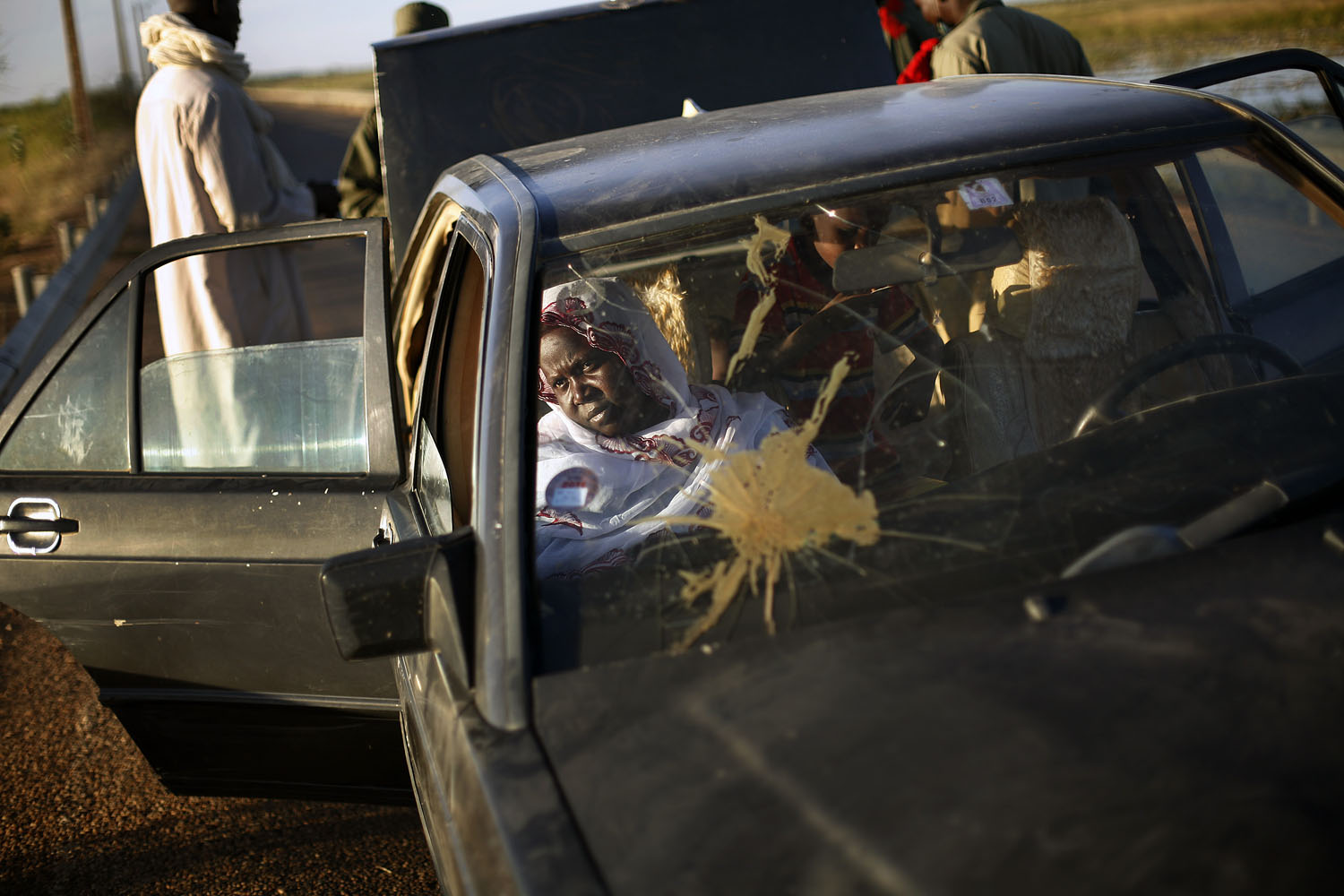A Malian woman waits at a checkpoint on the banks of the Niger river outside Gao, Feb. 7, 2013.