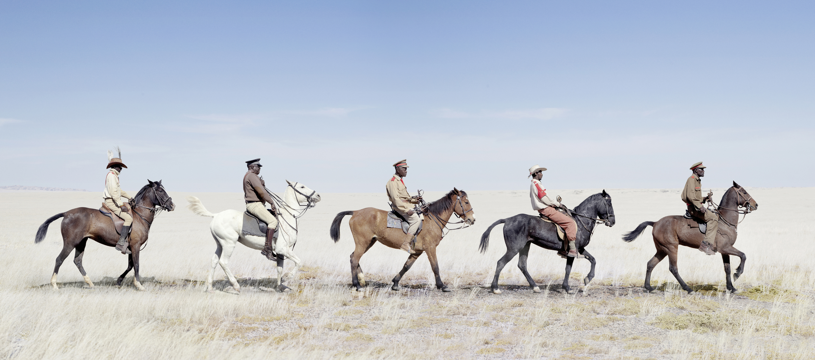 A group of Otruppe cavalrymen on horseback. Equestrian displays can be seen at festivals and ceremonies such as Herero Day.