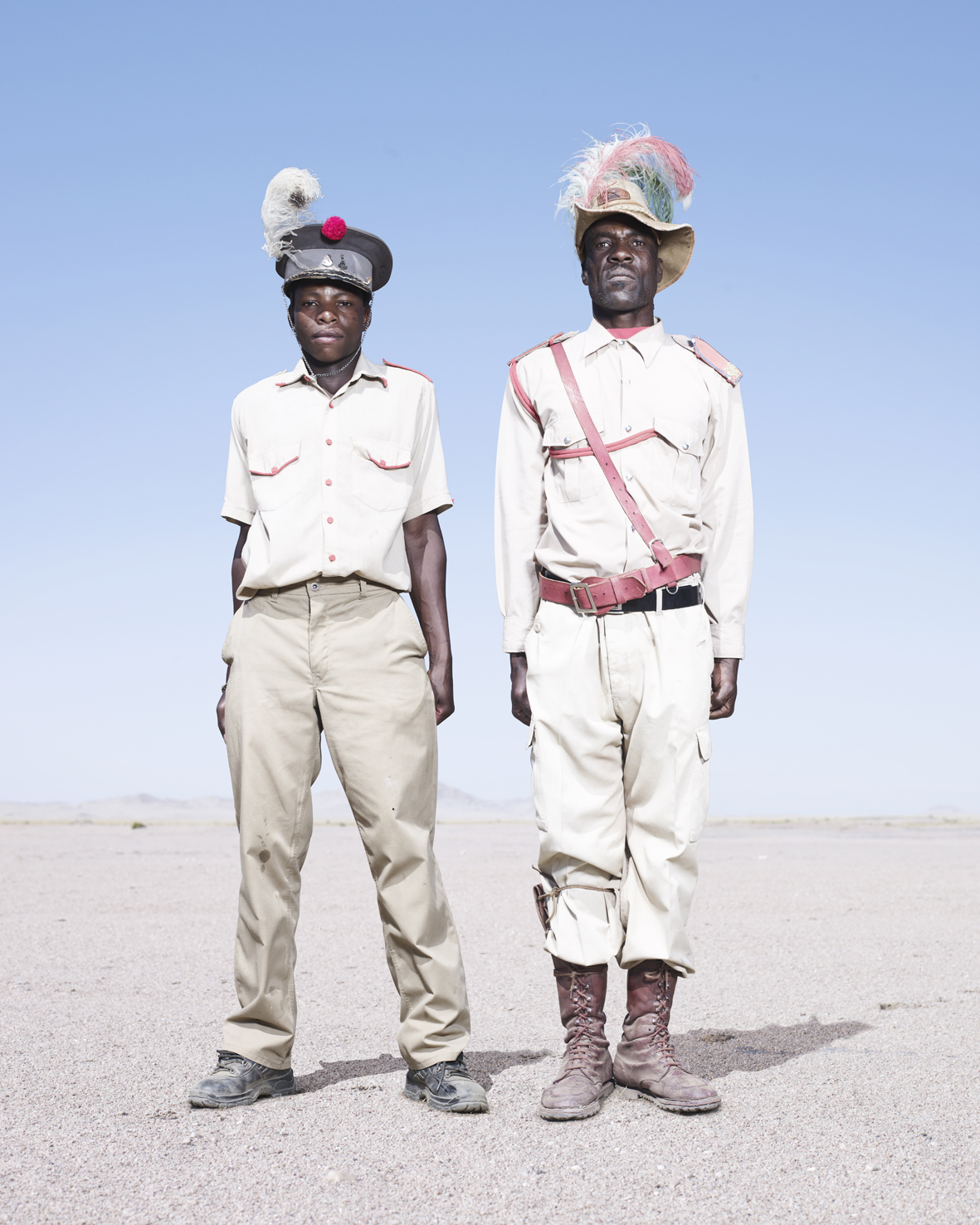 Two Otruppe cavalrymen. Their hats are adorned with colored ostrich feathers.