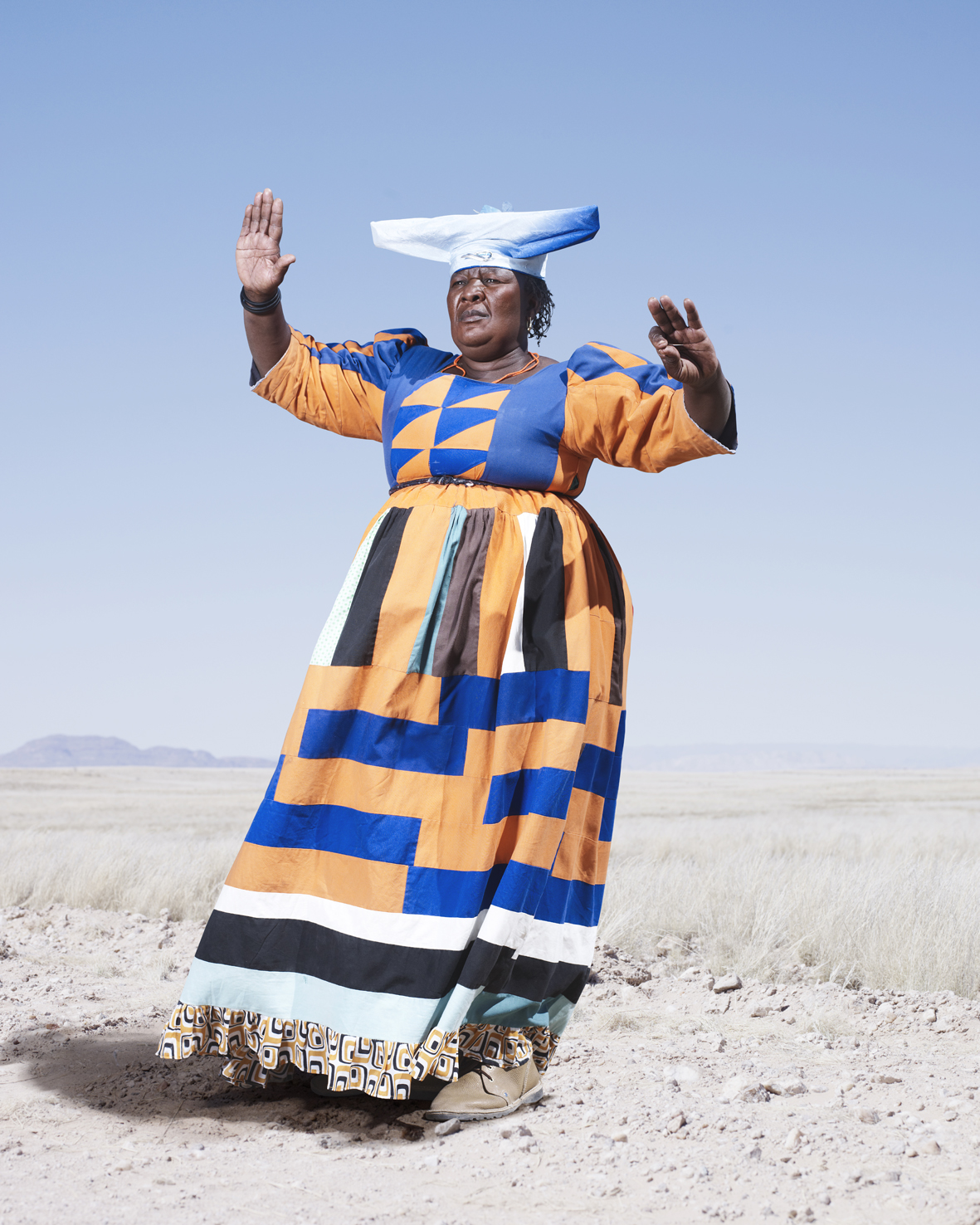 A Herero woman demonstrating the cow dance. Although relatively little is know about the precise origins and meaning of the dance, it signals the centrality of cattle to Herero culture.