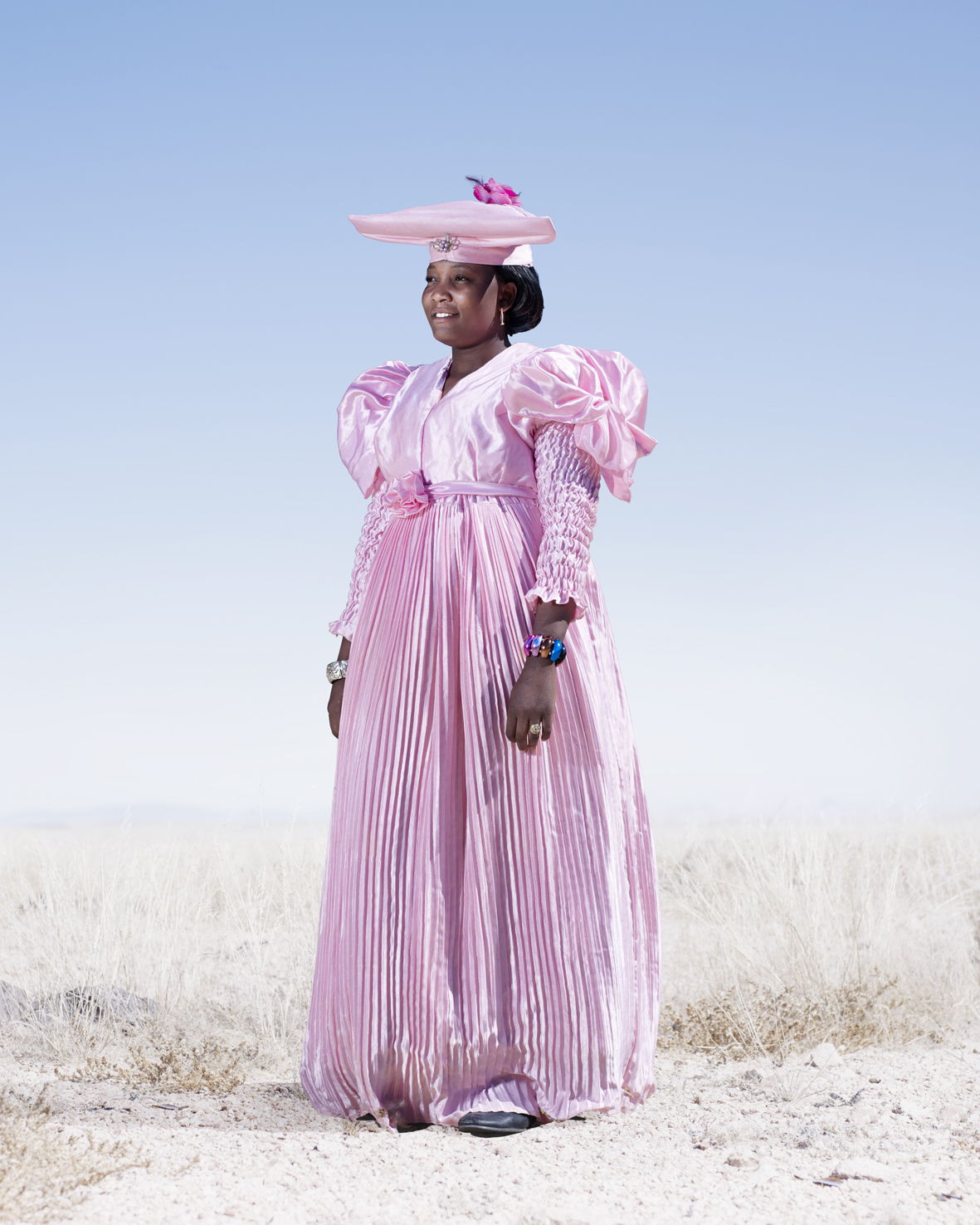 This women is dressed to attend a funeral. Herero funerals can last for several days, with funeral-goers, who often travel long distances in order to pay their respects, camping at the funeral site.