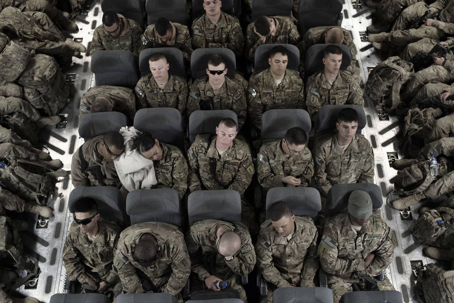Soldiers from the 101st Airborne and 1st Infantry Divisions await takeoff in the C-17 Globemaster that will take them from Bagram to Manas Airbase in Kyrgyzstan. There, they will await contracted flights home.