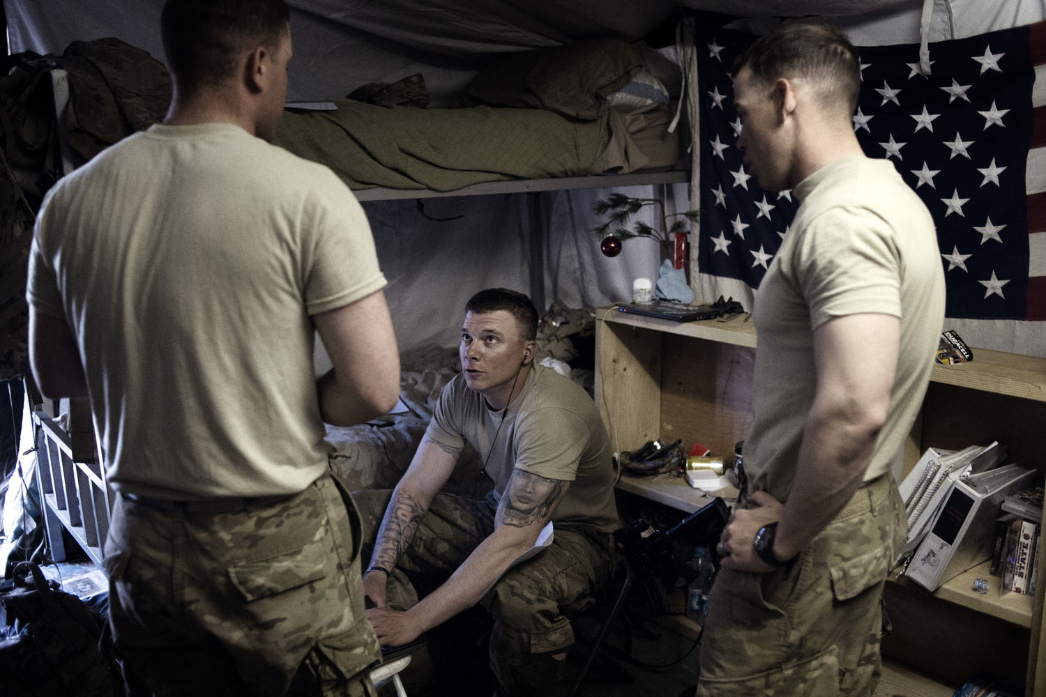 Paratroopers from 4th Battalion, 319th Airborne Field Artillery Regiment, pack their gear in preparation to load containers at Forward Operating Base Altimur, Logar Province, Afghanistan. The soldiers' gear will be shipped to their home base in Germany before they depart the country.