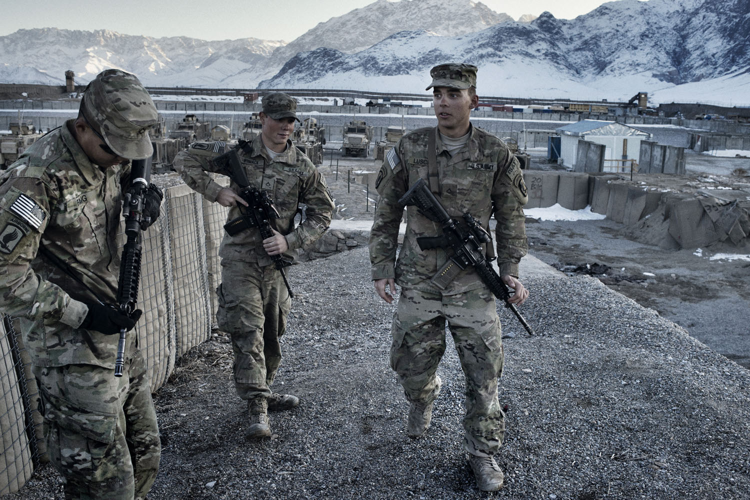 (From L to R) Private First Class YuanYun Fang, 19, Private First Class Kyle Womack, 19 and Private First Class Tyler Luscan, 20, at Forward Operating Base Altimur, Logar Province, Afghanistan. The soldiers, members of Bull Battery, 4-319 Airborne Field Artillery Battalion, all joined the Army less than two weeks after finishing high school and have served a nine-month combat tour together in eastern Afghanistan.