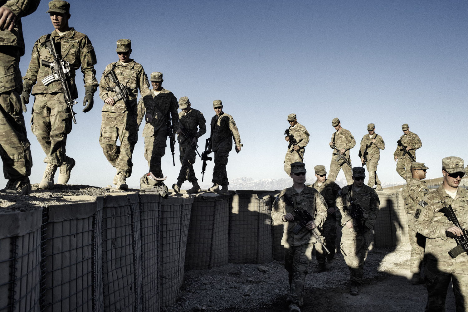Paratroopers from Bull Battery, 4-319th Airborne Field Artillery Battalion line up for their final unit photo before leaving Afghanistan for their home base in Germany. The traditional unit picture is often one of the last events before soldiers leave a combat zone. Bull Battery has served a nine-month combat tour in eastern Afghanistan.