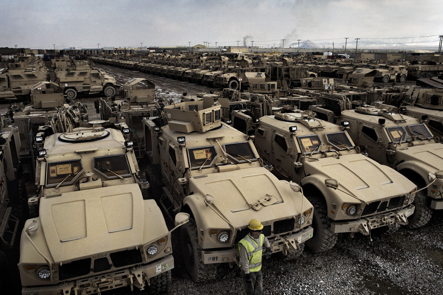 Rows of armored combat vehicles are staged in a yard at Bagram, waiting for shipment back to the United States.                                Logistics units at Bagram can ship nearly 500 vehicles every month. Within two weeks, they say, this yard will have been emptied and refilled with more vehicles awaiting transport home. With most U.S. forces set to depart Afghanistan by the end of 2014, retrograde, the military's term for the removal of combat equipment from the country, has become a top mission.