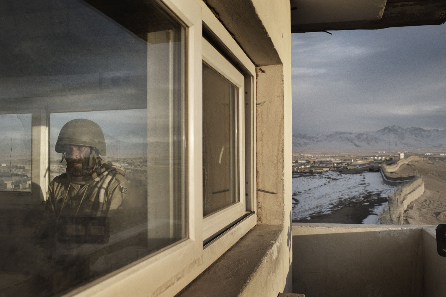 An Afghan soldier guards the perimeter of Forward Operating Base Shank in Logar Province, Afghanistan.