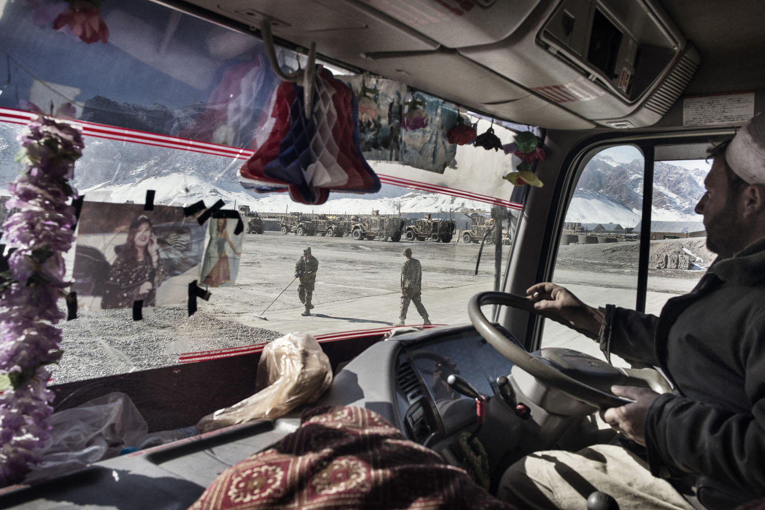 Ali Khan, a Pashtun Afghan from Gardez, drives his truck on Forward Operating Base Altimur after paratroopers from 4-319 Airborne Field Artillery Battalion loaded it up with equipment.