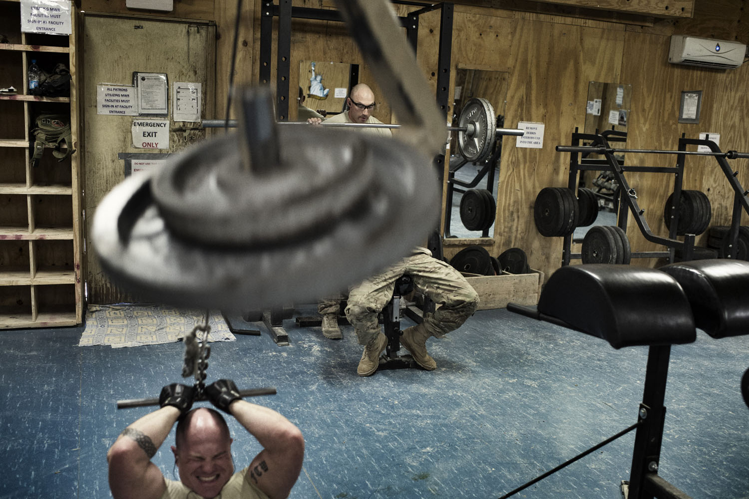 Paratroopers from 4th Battalion, 319th Airborne Field Artillery Regiment lift weights in the gym at Forward Operating Base Altimur, Logar Province, Afghanistan. The soldiers moved equipment from FOB Altimur in preparation to hand the base over to Afghan forces.