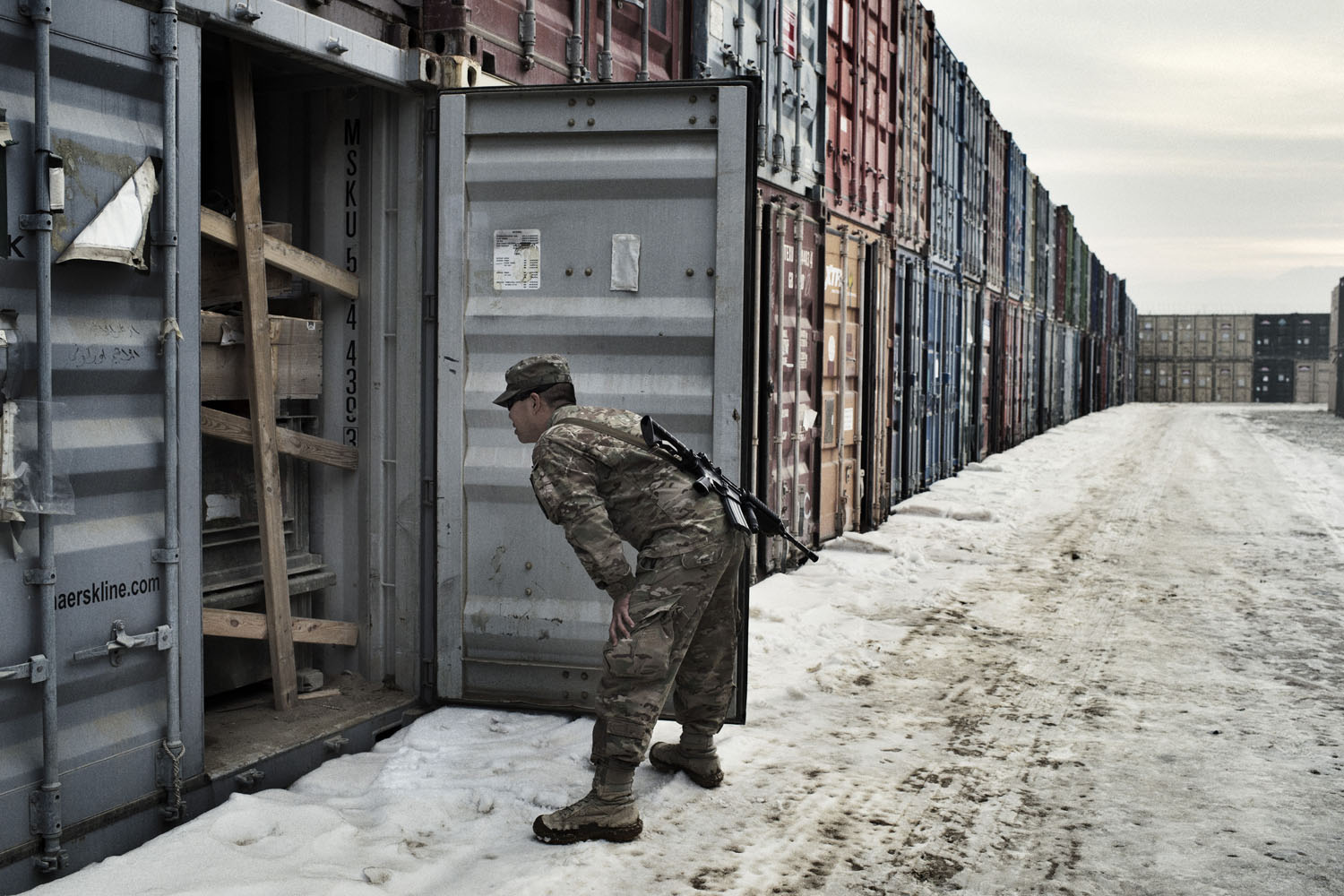First Lieut. Henry Chan of the 18th Combat Sustainment Support Battalion opens containers to find out what is inside at a container yard at Bagram.