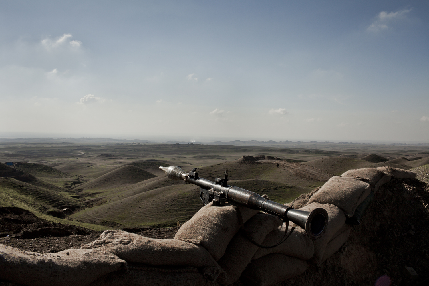 A rocket launcher belonging to Peshmerga soldiers is seen on the frontline in Kirkuk, looking out toward Iraqi army positions in the valley below.