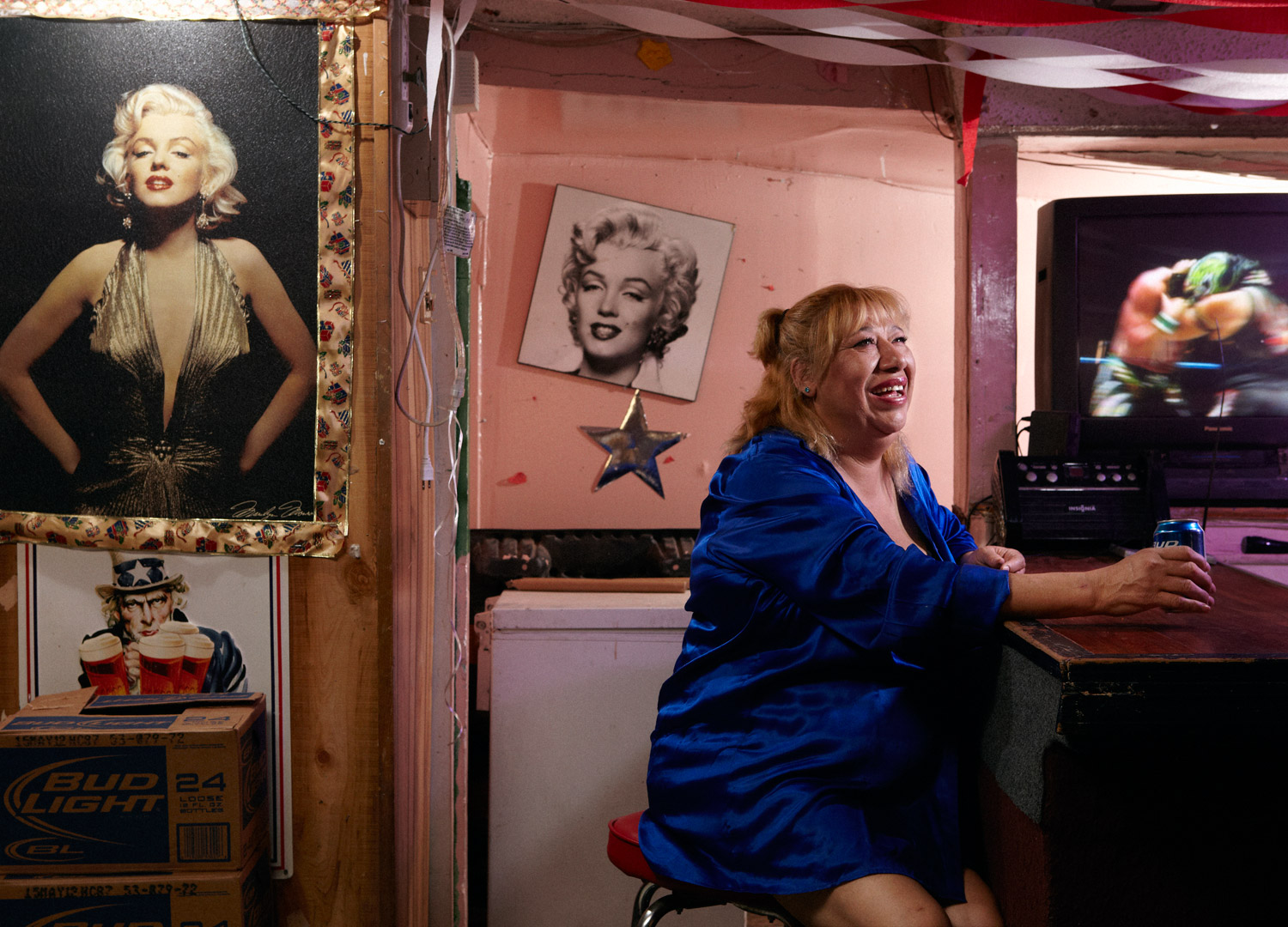 """""""Goldie"""" crossed the border when she was 16 and started dancing at a topless bar where most of the dancers were illegal immigrants from Juarez. She soon left that life behind, and now she owns Goldie's Bar, a tiny cantina in an industrial section of south central El Paso. The walls of Goldie's Bar are littered with pictures of her hero, Marilyn Monroe: """"I like that she often said that women should be liberated, that men shouldn't limit them, that a woman should be the way she wants to be."""""""