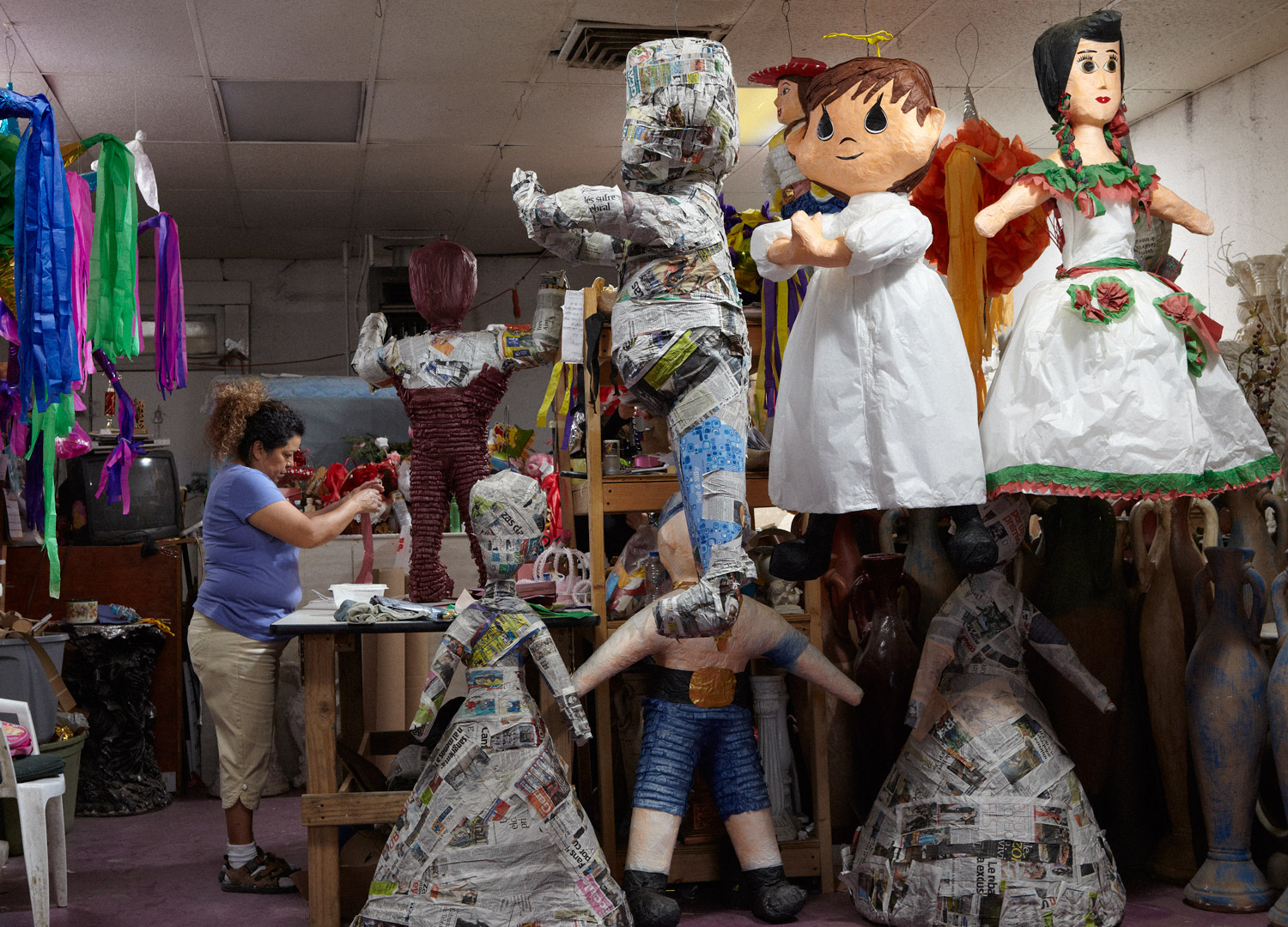Alameda Avenue is the unofficial piñata district of El Paso. On nearby side streets you can find big papier-mâché forms drying in backyards. Josefina buys the forms wholesale and then dresses them herself.