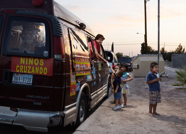 Rosa and her makeshift ice cream truck delight the neighborhood kids.
