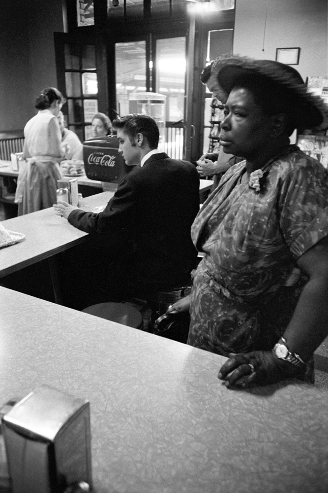 July 4, 1956. Chattanooga railroad station. This is a segregated lunch counter. This woman got suspicious of me, ordered a tuna fish sandwich and walked in front of my lens. She then moved when she picked up her sandwich to go to the waiting room to eat.