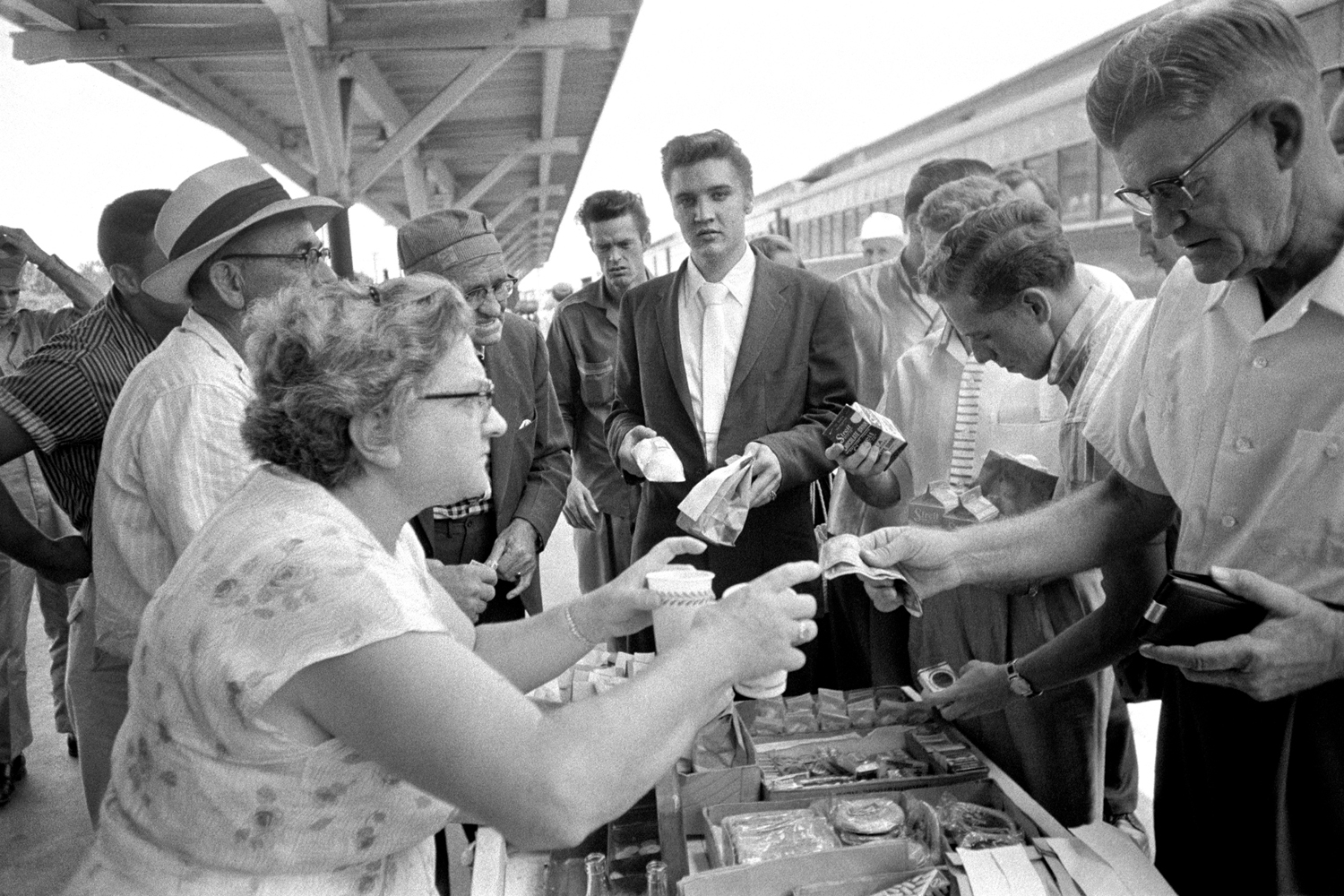 July 4, 1956. Lunchtime in Sheffield, Alabama. He's got his snowcones and chicken wings…and his chocolate milk. Elvis never paid for anything, because he never knew where his money was. I was told that one time RCA gave Elvis $500 petty cash and he forgot where he put it. Elvis was too busy being Elvis — that was enough for him.