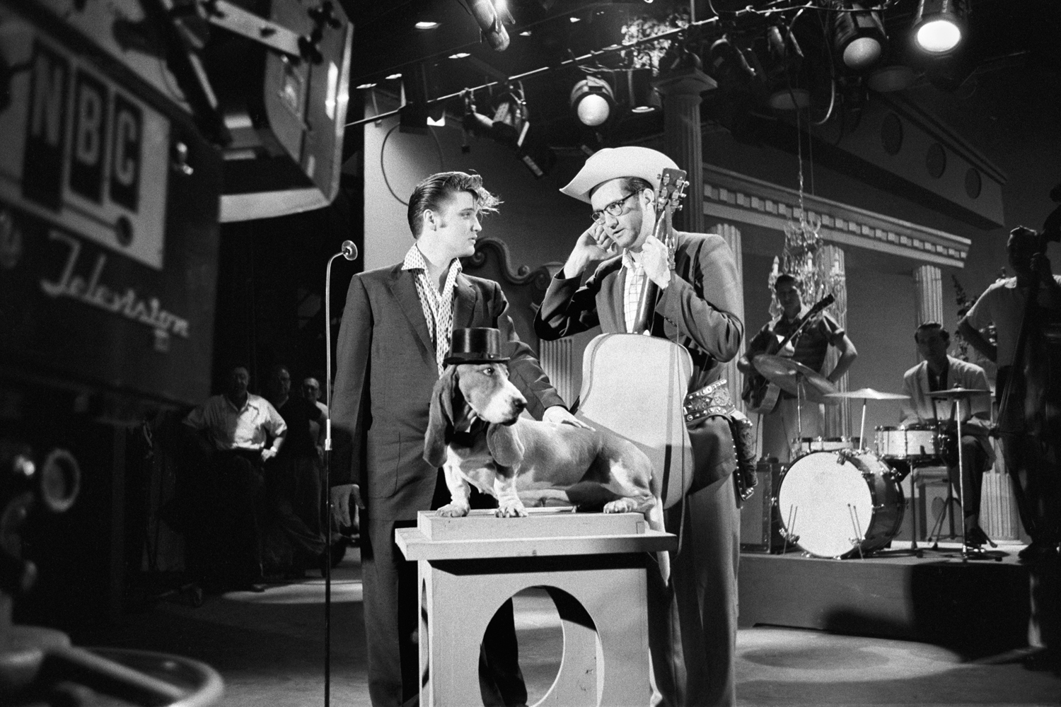 July 1, 1956. The Hudson Theatre, New York. Dress rehearsal for the Steve Allen Show. My classic  show business photograph. Steve Allen with his six shooter, Elvis, a dog, guys with musical instruments, Greek columns, stage hands and lighting overhead. I just like the way all the elements come together — how could it be more theatrical?