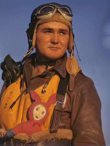 American bomber crew member with stuffed good-luck charm during World War II, England, 1942.
