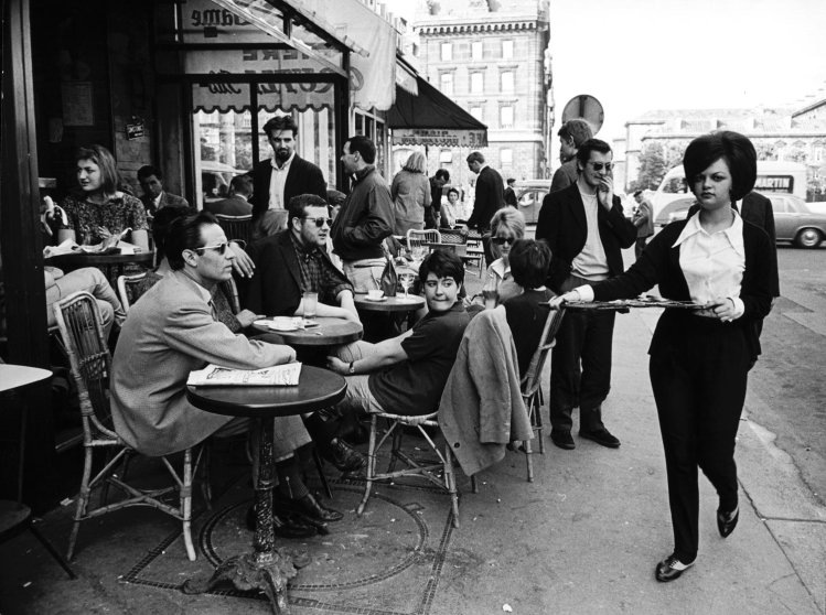 Parisians at a sidewalk cafe, 1963.