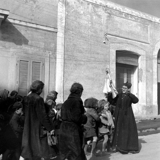 Priest and children during the 1944 eruption of Mt. Vesuvius, Italy.