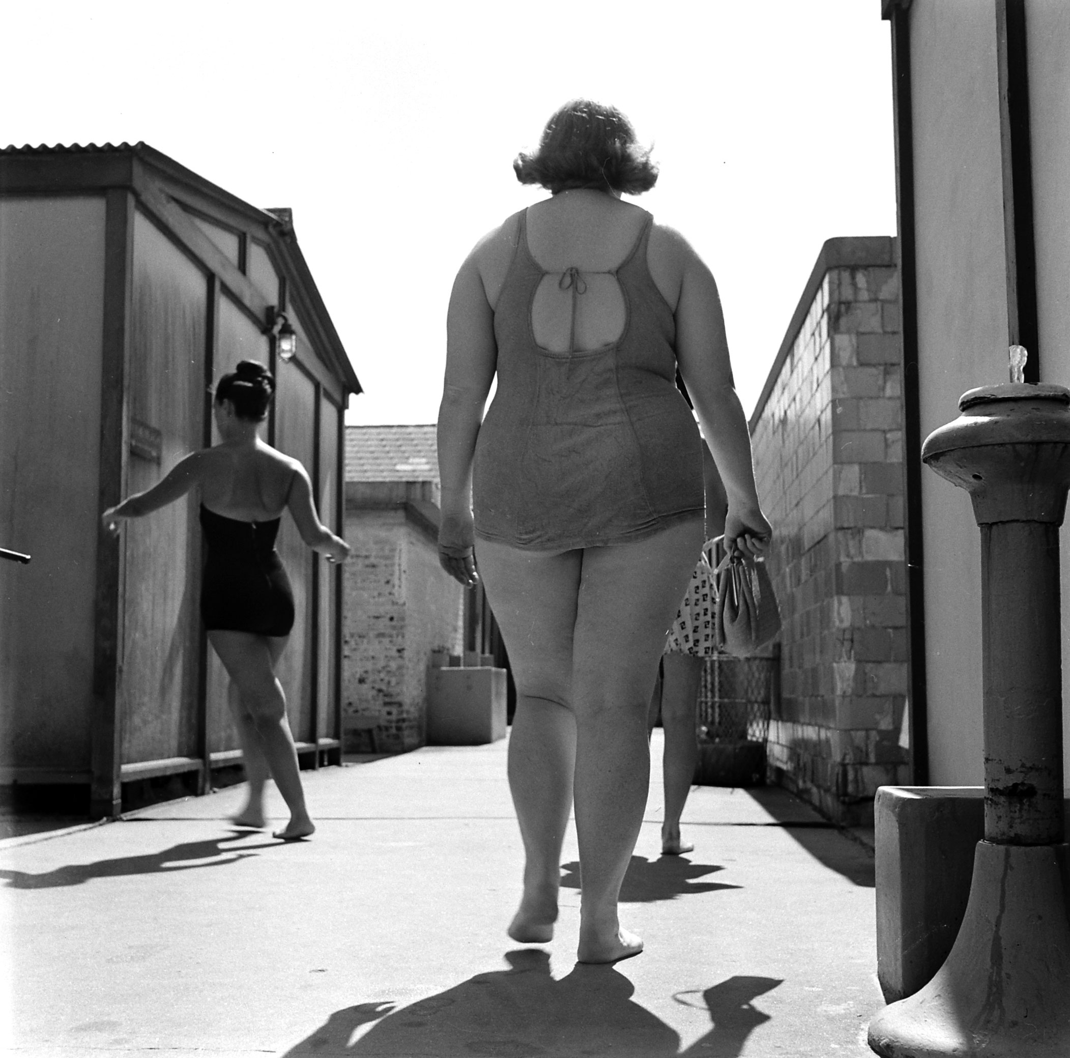<b>Caption from LIFE.</b> Bulging at beach in 1949, 197-pound Dorothy [Bradley] self-consciously leaves locker room for swim. She covered up embarrassment by being jolly and gregarious.