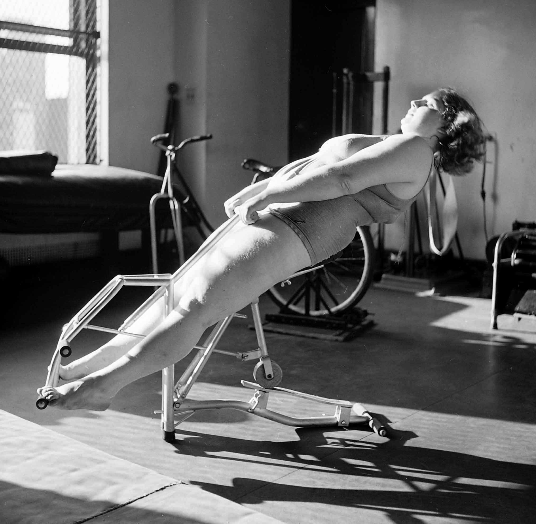 Dorothy Bradley, photographed for LIFE magazine article on obesity, works out in 1949.