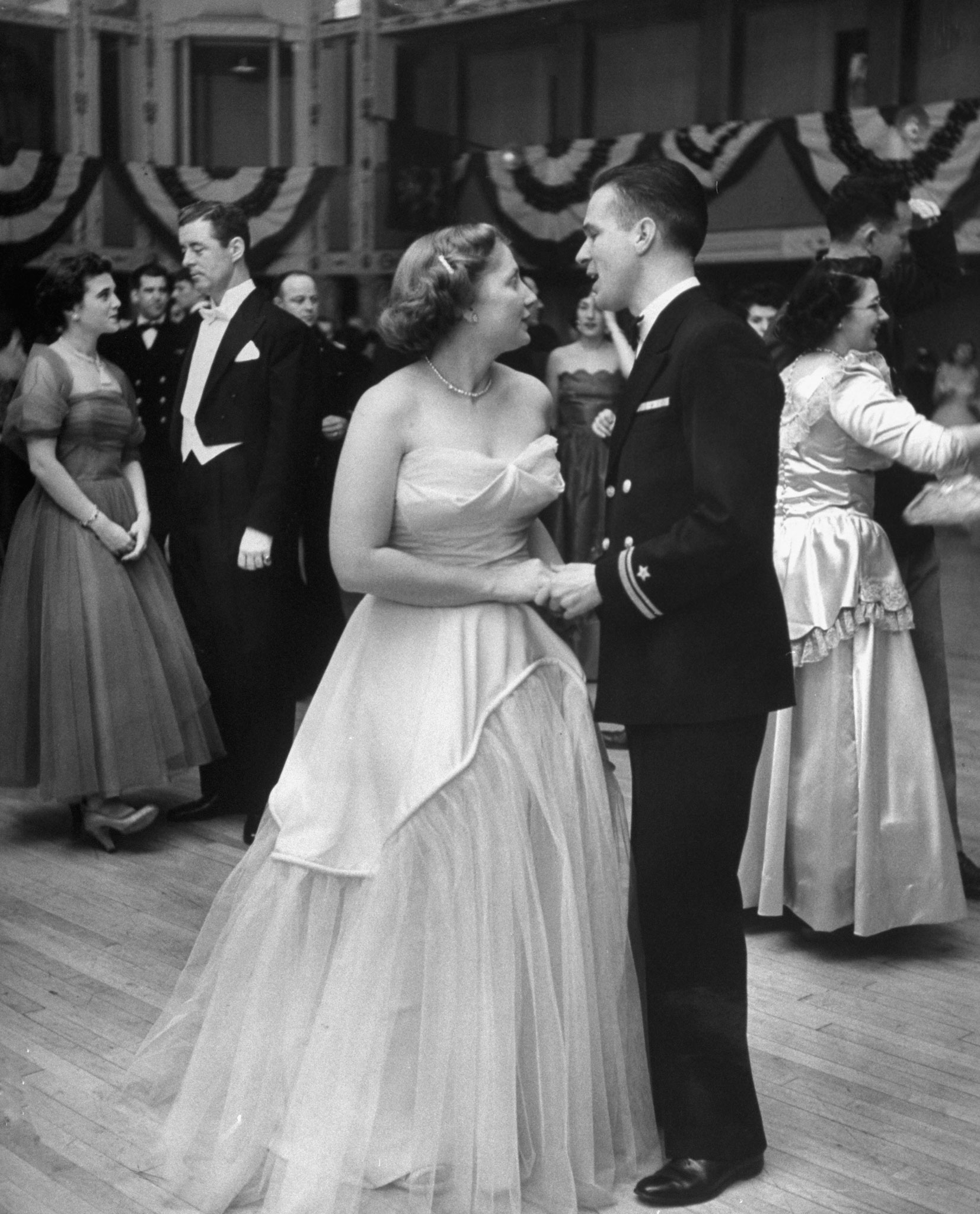 <b>Caption from LIFE.</b>Now down to 155 pounds, an attractive Dorothy dances at Navy Ball.