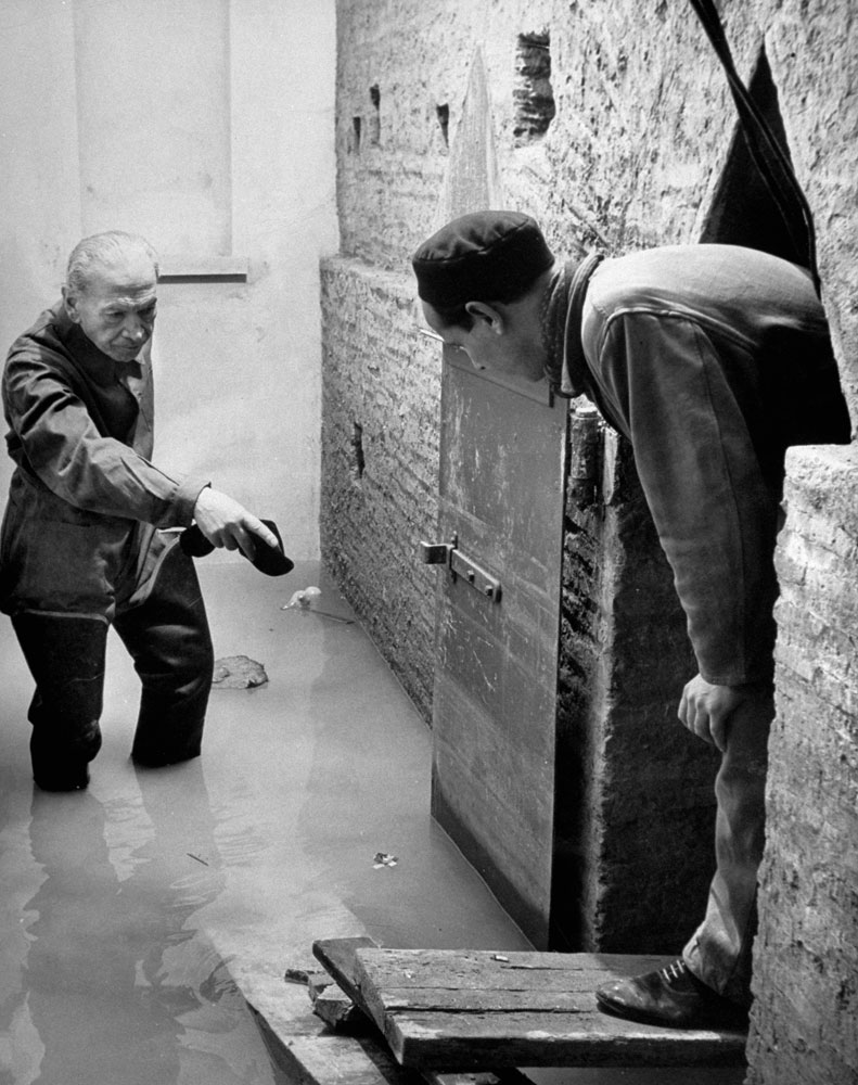 Workers gauge damage from water seepage during the excavation beneath St. Peter's in Rome, 1950.