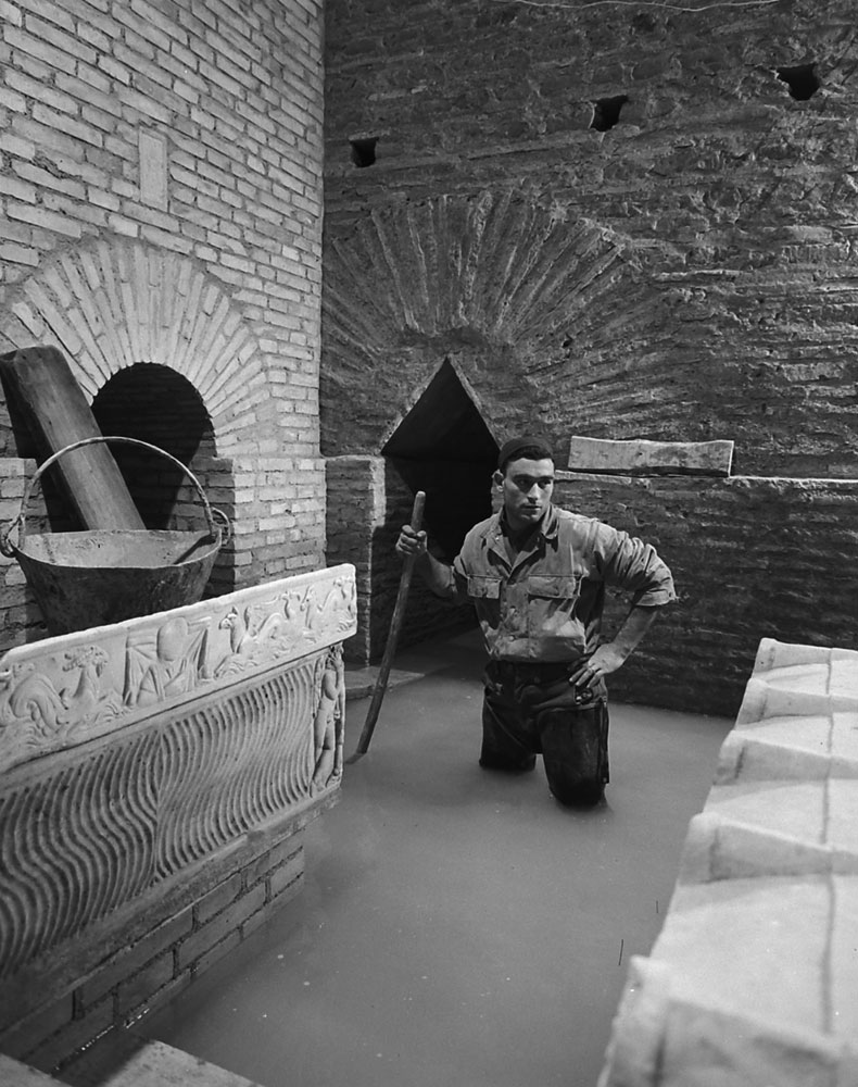 Gauging damage from water seepage during the excavation beneath St. Peter's in Rome, 1950.