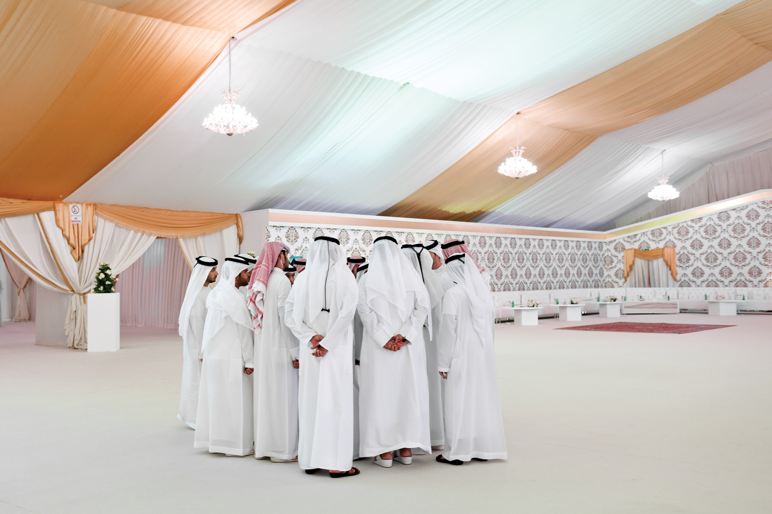 Security personnel receive a briefing during a wedding of a member of the royal family in Umm Al Quwain, an Emirate in northern UAE.