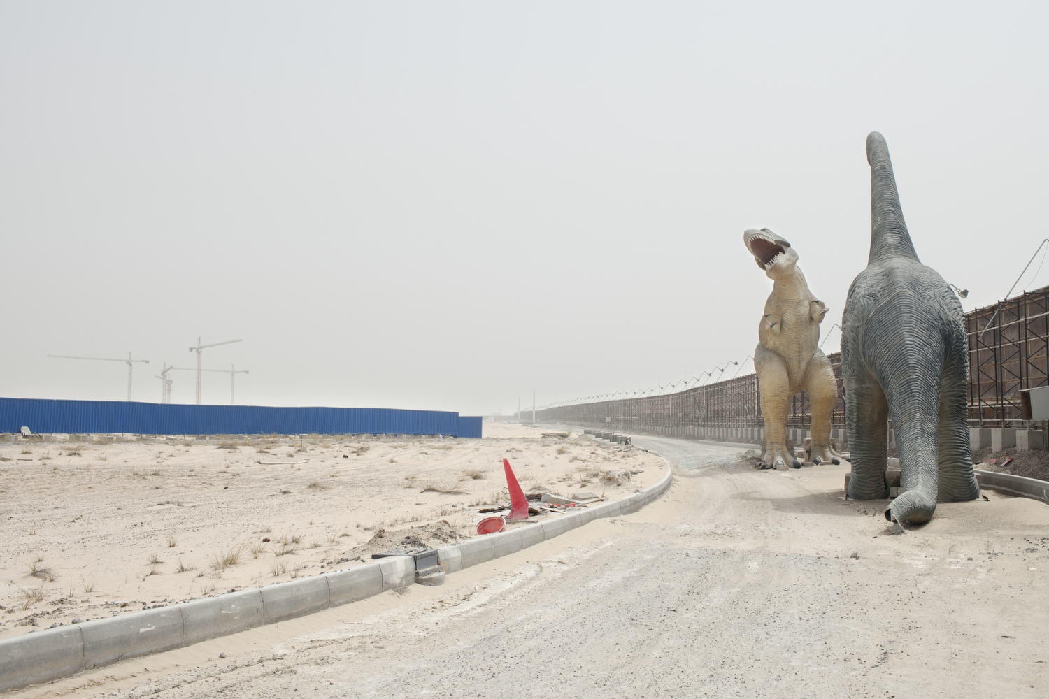 Dinosaur statues at the abandoned project site of the Falcon City of Wonders in Dubai.