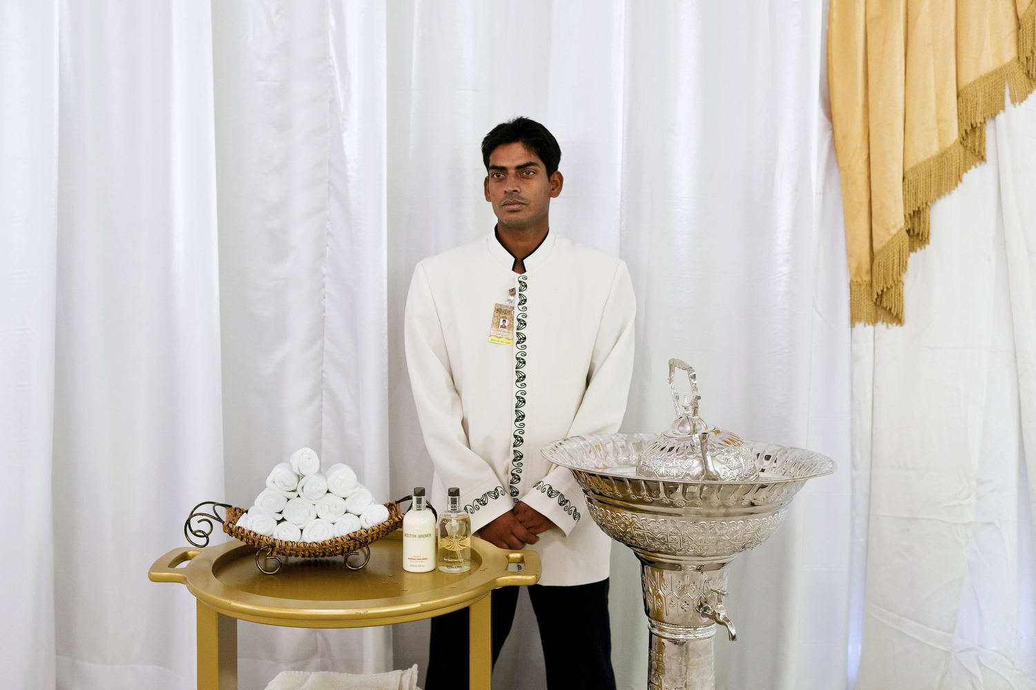 A servant waits at a hand-washing station during a royal wedding in the northern Emirate of Umm Al Quwain.