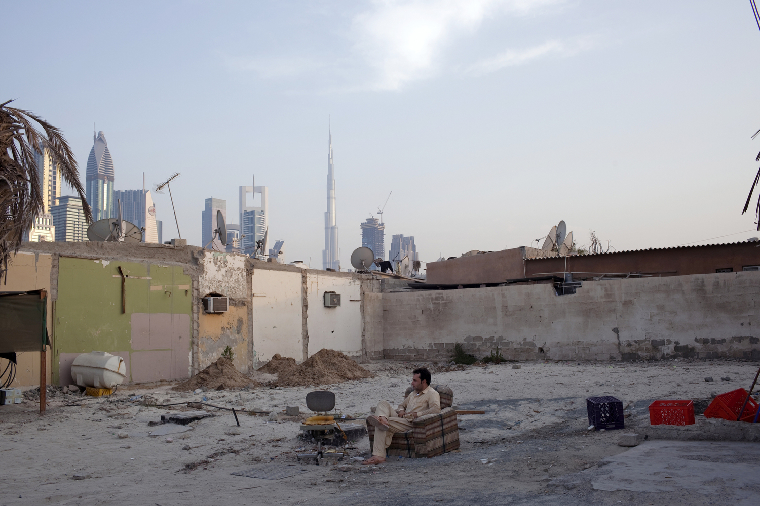 A laborer rests in an abandoned lot in the Al-Satwa neighborhood of Dubai.