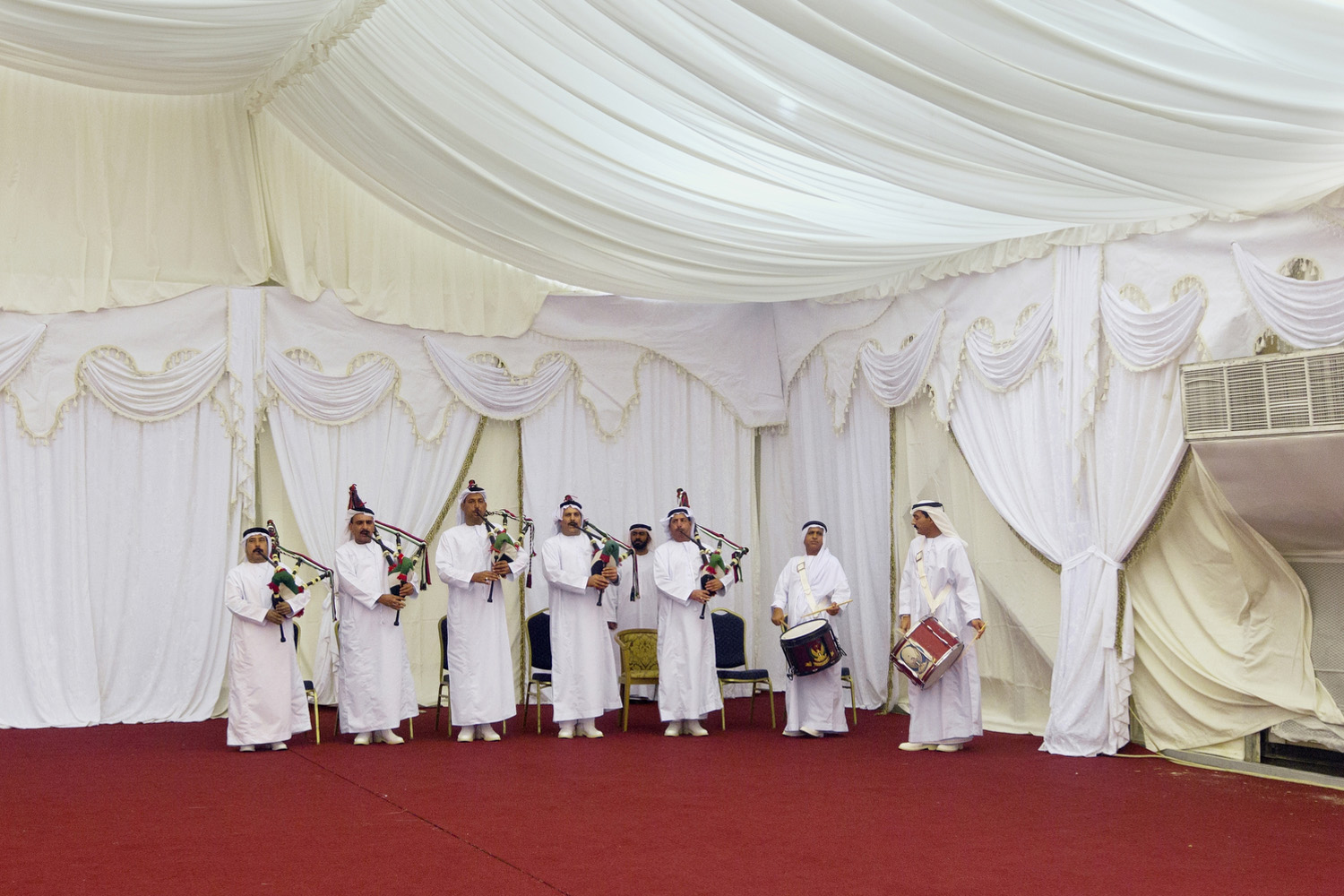 A UAE military band plays bagpipes and drums for the arrival of VIPs during a dinner reception in Abu Dhabi.