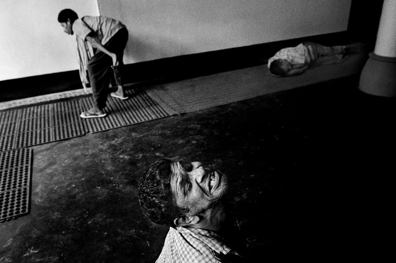 Patients suffering from suspected mental illness inside a center run by volunteers in Thodupuzha, Kerala. August 2009.