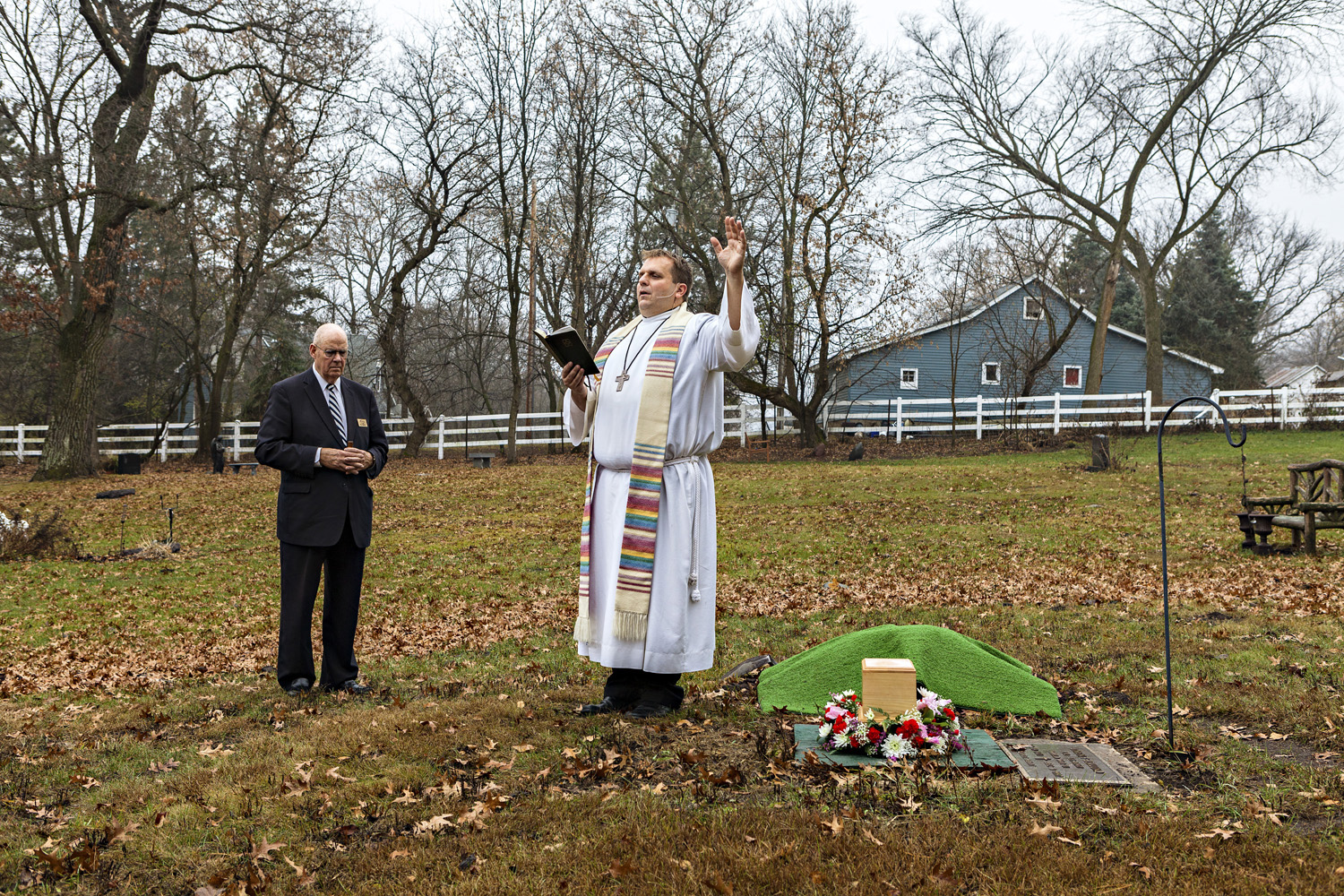 Pastor Joel Martin of Christ Lutheran Church presides over the burial of the woman's ashes next to the remains of her husband in Oakland Cemetery.