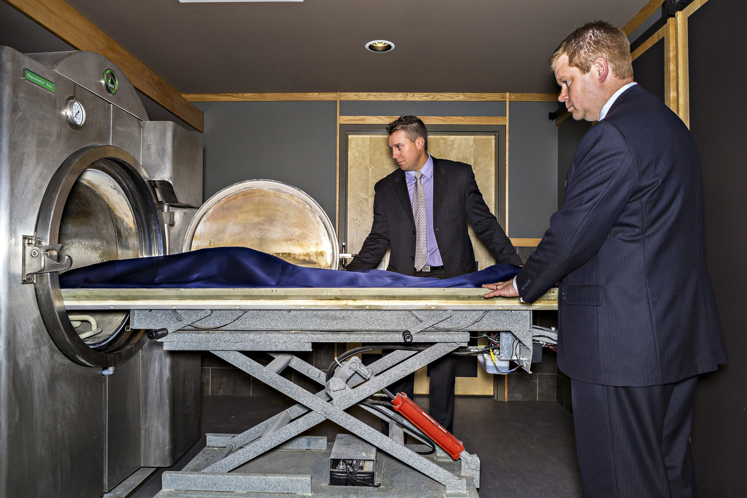 Jason Bradshaw and employee Cameron Black place a body in the Resomator.