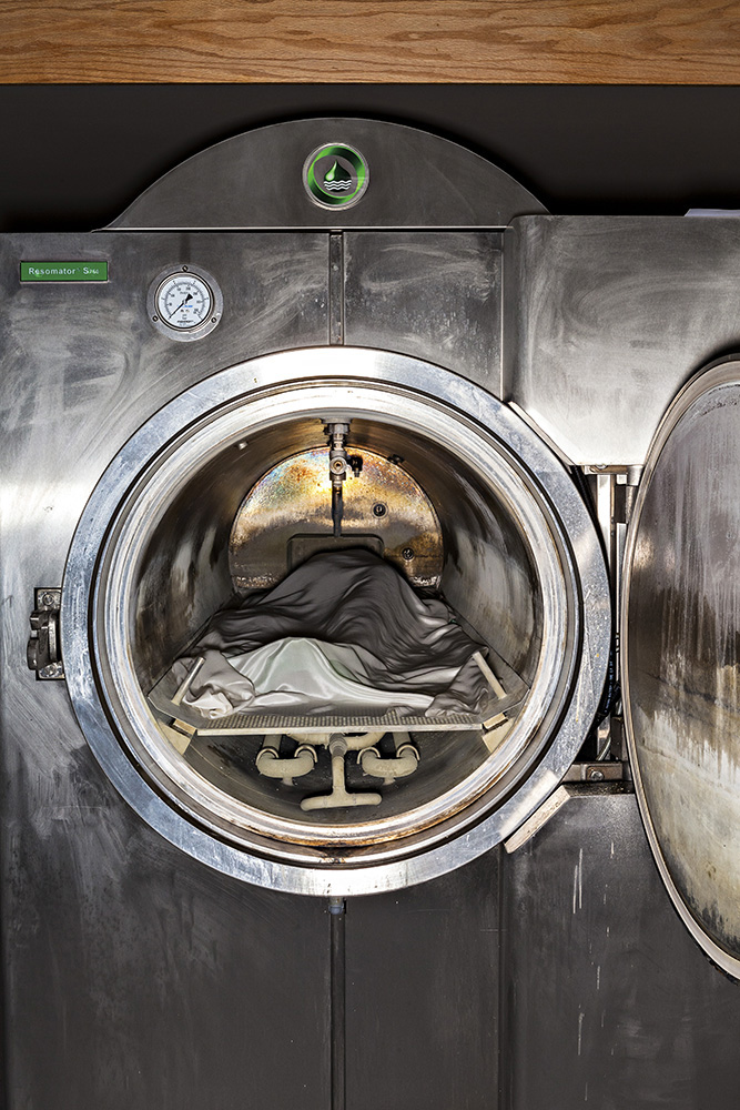 A dead body ready for cremation has just been inserted into an eco-friendly Resomator machine. Instead of flames, this stainless steel chamber owned by Bradshaw Funeral and Cremation Services uses a combination of water, potassium hydroxide and heat to break down bodies into peptides, soaps, salts and sugars.