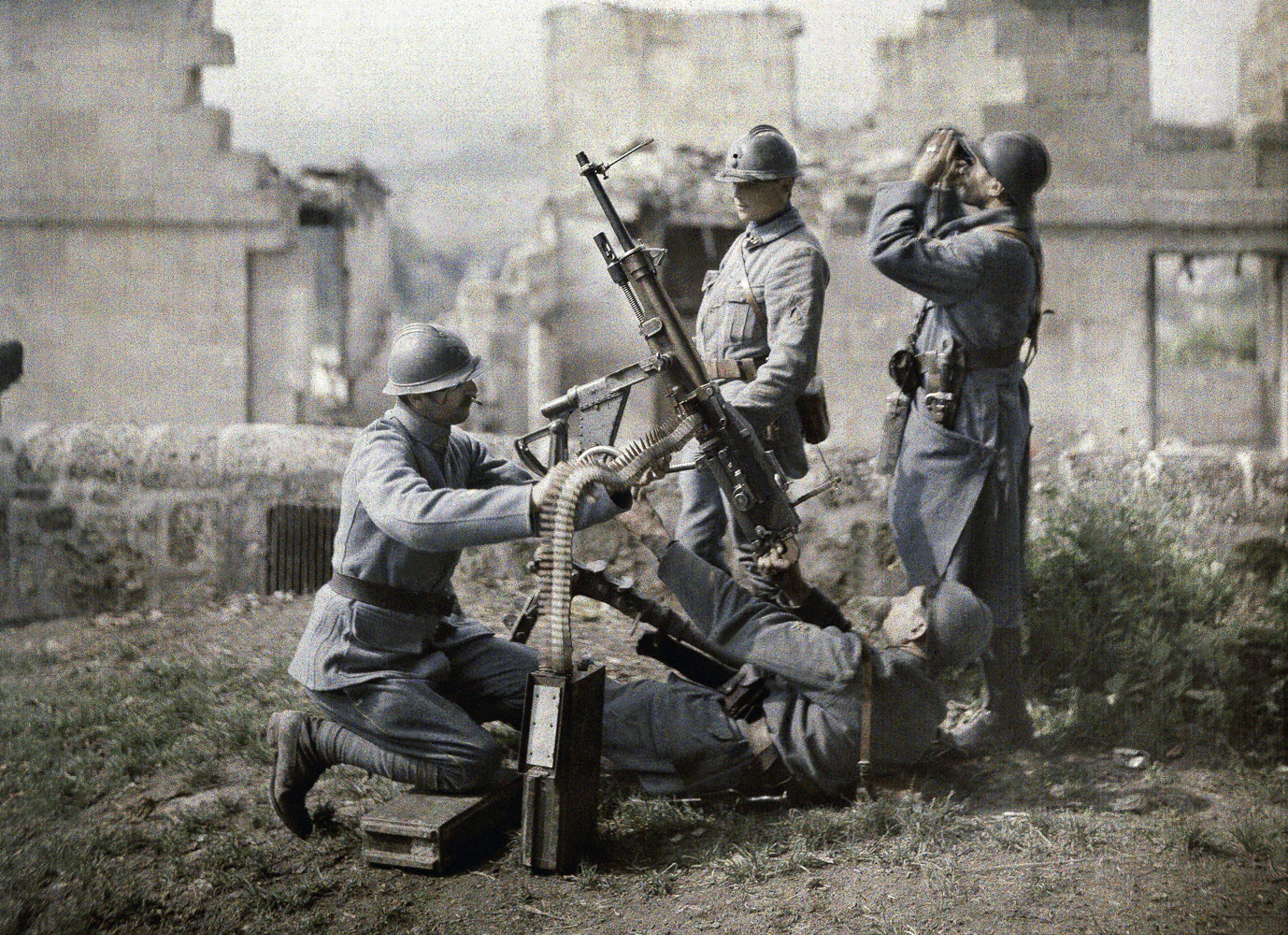 A French section of machine gunners take positions in the ruins during the battle of the Aisne in 1917.