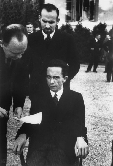 Hitler's Minister of Propaganda Joseph Goebbels glowers at photographer Alfred Eisenstaedt in the garden of the Carlton Hotel during a League of Nations conference, Geneva, September 1933.