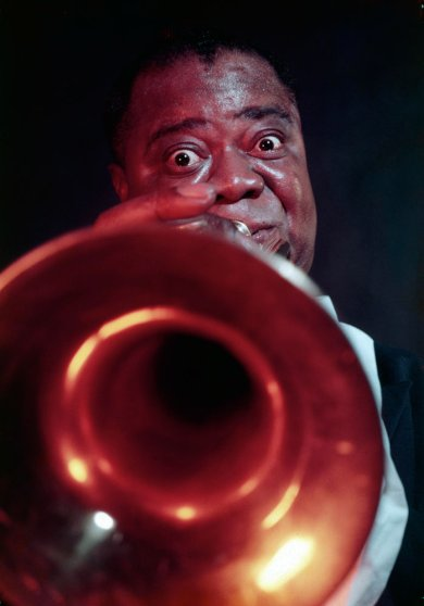 With his trumpet glowing like a hot coal, Louis Armstrong first ripped into jazz in New Orleans 37 years ago .... [He is] a superb musician and a clear spellbinder.