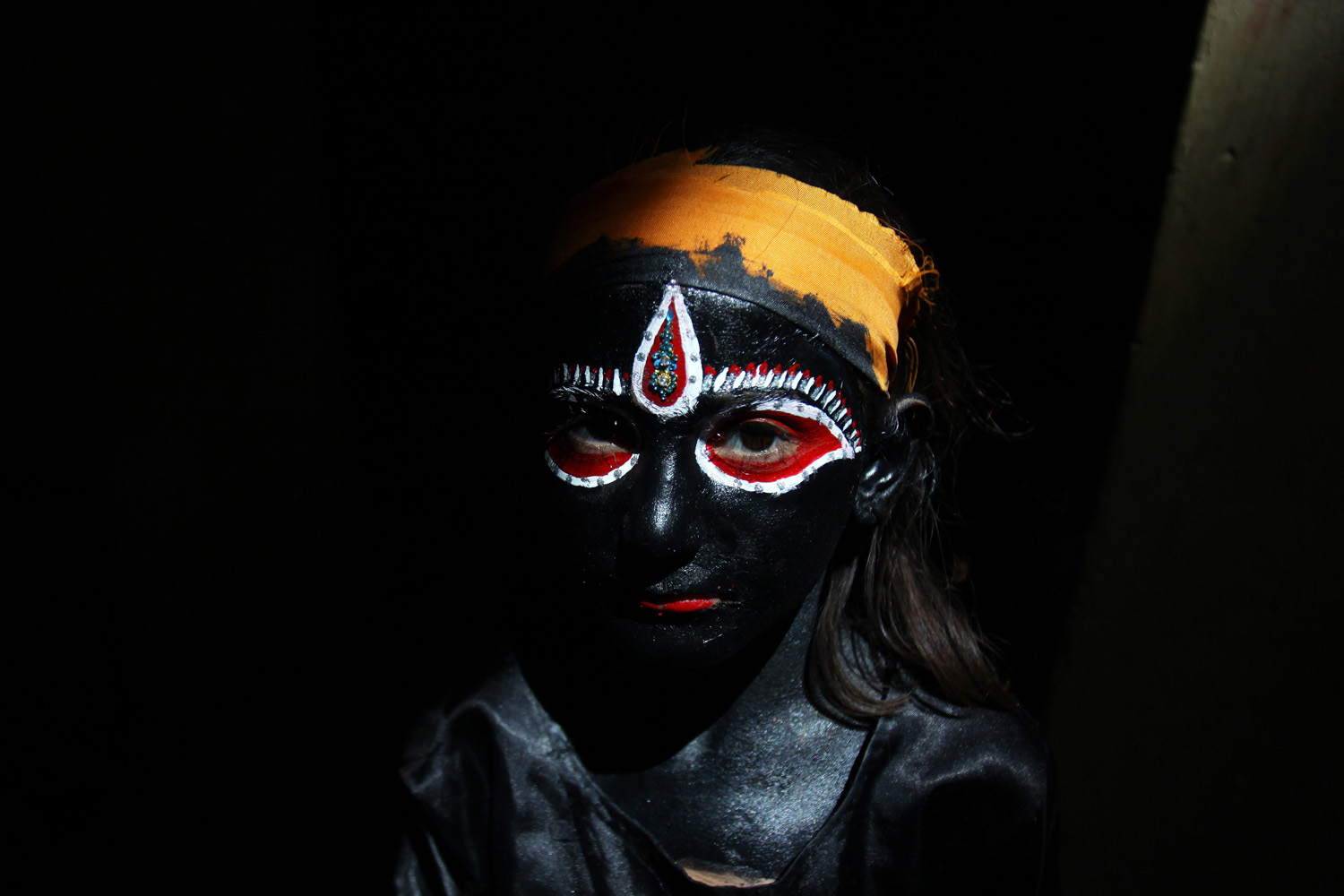 April 19, 2013. An Indian girl dressed as Hindu Goddess, Kali prepares to take part in a religious procession taken out on the occasion of Ramnavmi festival in Amritsar, India. The festival commemorates the birth of Hindu God Lord Rama.