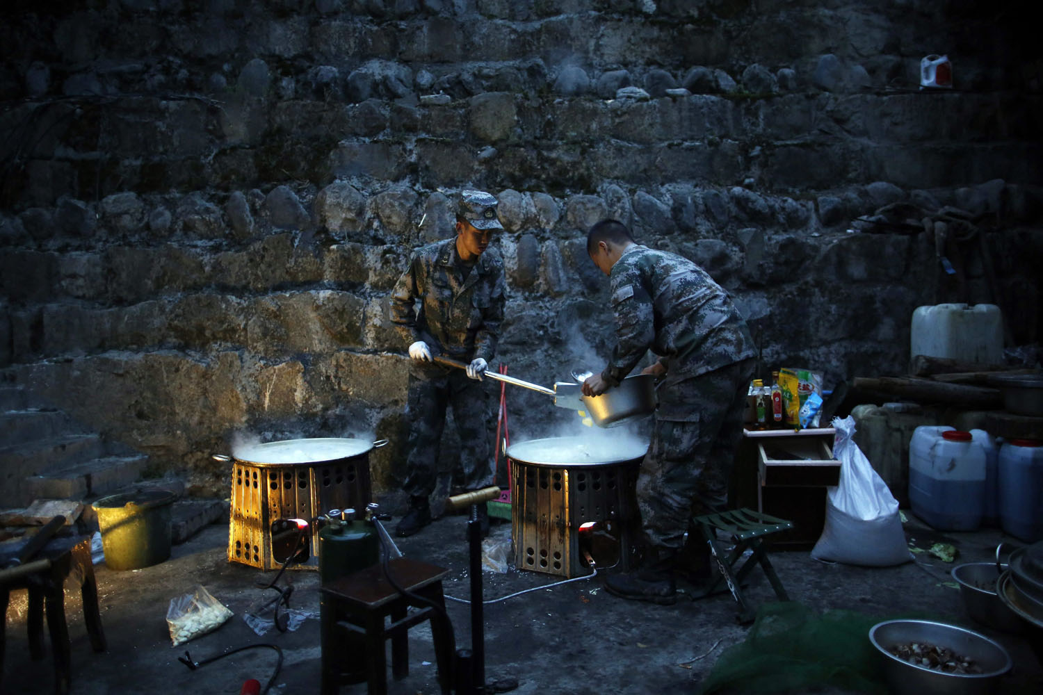 April 23, 2013. Chinese soldiers cook breakfast in a rescue camp in Taiping town, Lushan County, Sichuan Province, China.