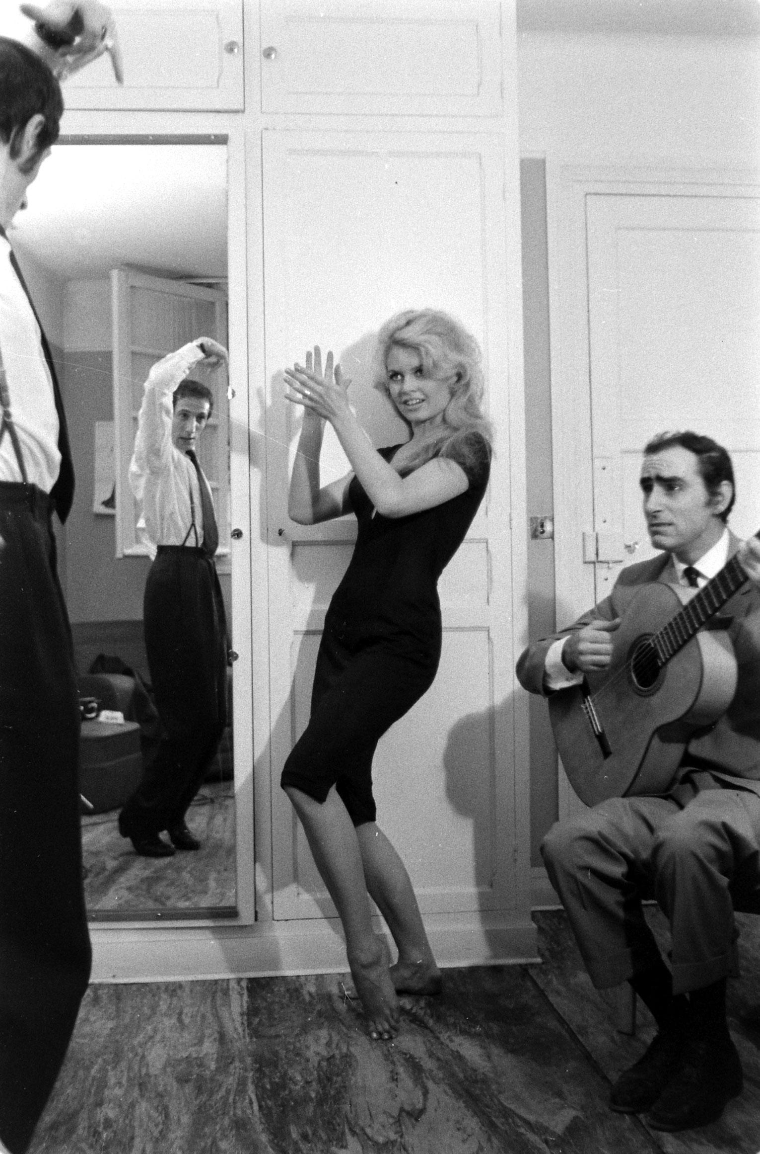 Brigitte Bardot (center) on the set of the film, <i>La Femme et le Pantin</i>, Spain, 1958.