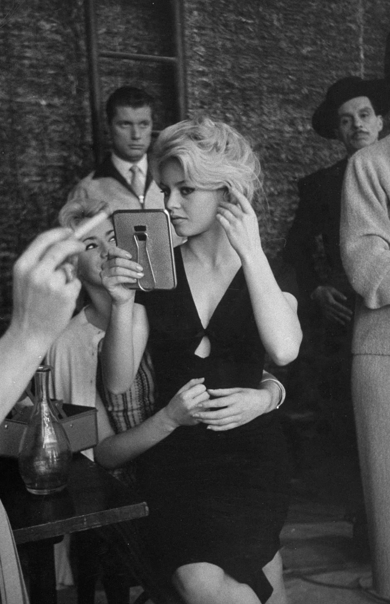 Brigitte Bardot checks her hair and makeup on the set of the film, <i>La Femme et le Pantin</i>, Spain, 1958.