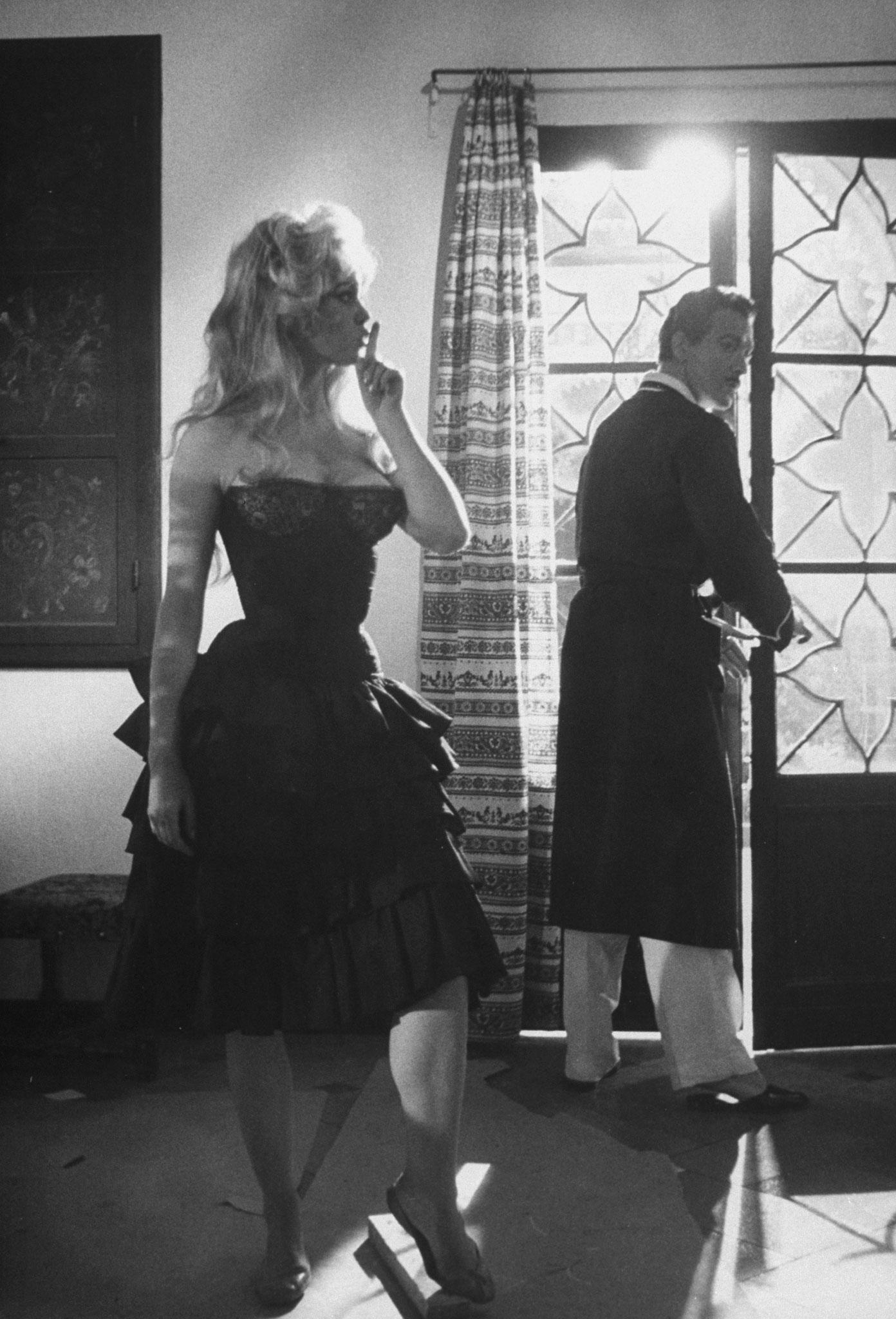 Brigitte Bardot with co-star Antonio Vilar on the set of the film, <i>La Femme et le Pantin</i>, Spain, 1958.