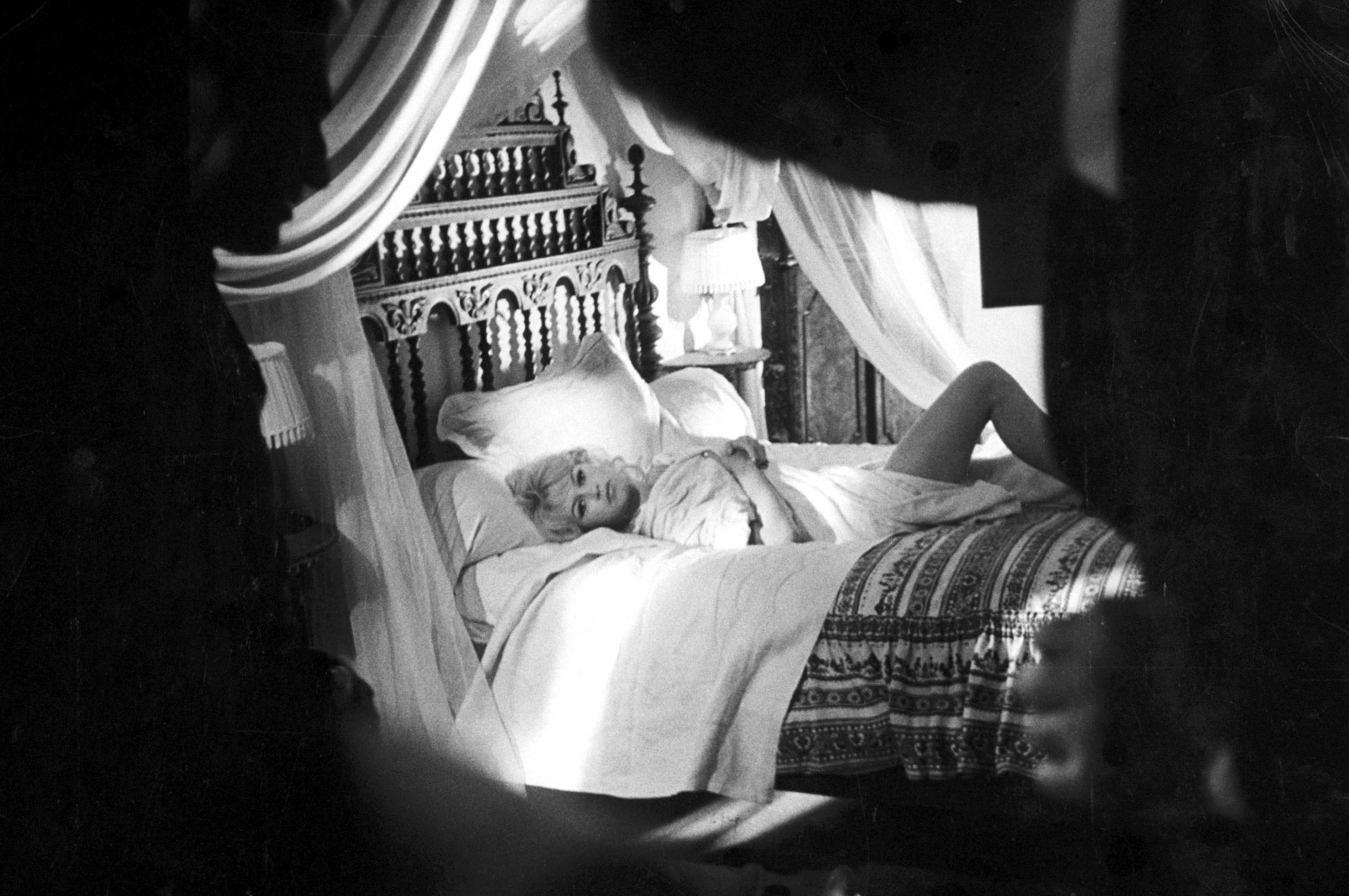 <b>Caption from LIFE.</b> Sooner or later in most of her films, Bardot is seen lounging on a bed ...